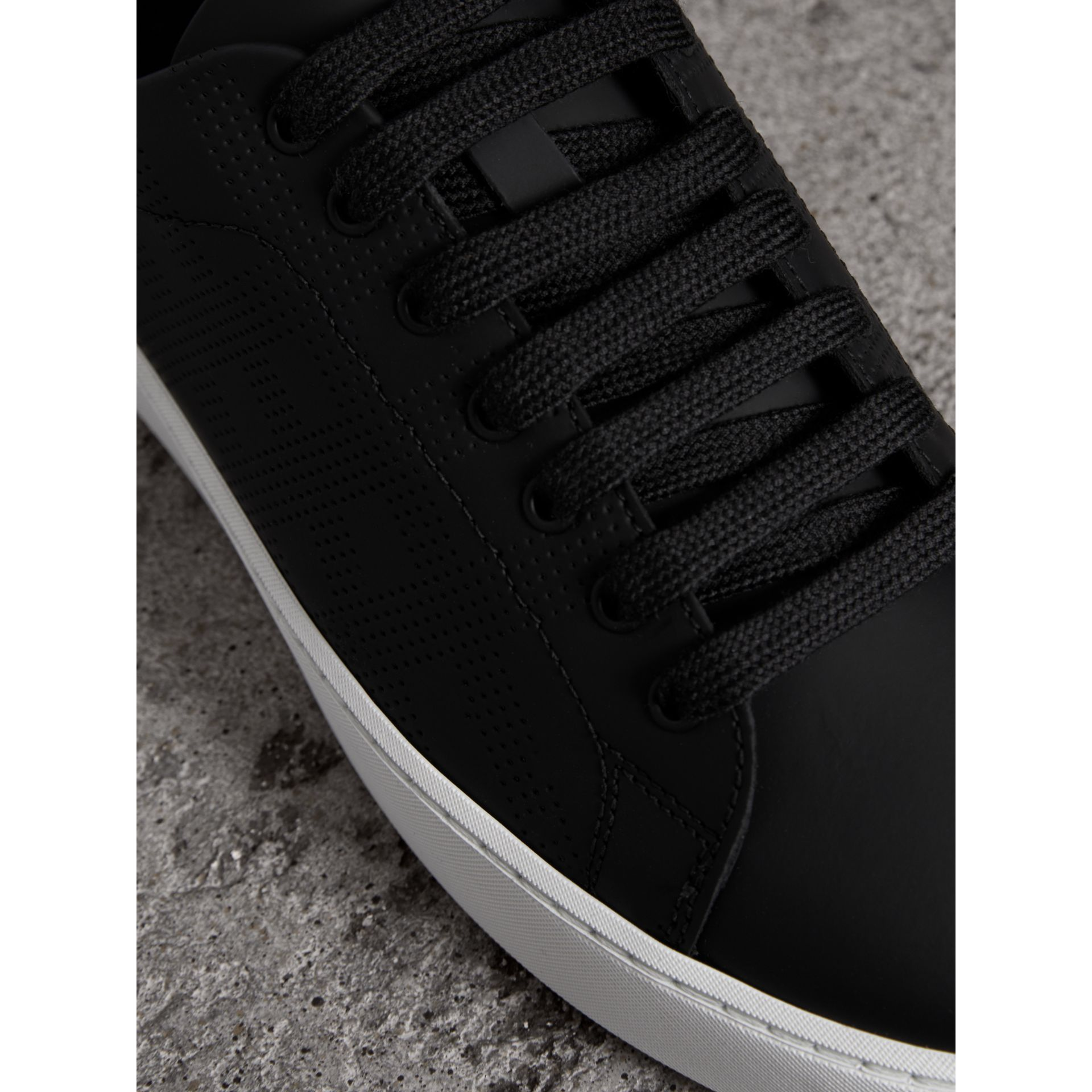 Perforated Check Leather Sneakers in Black - Women | Burberry United States - gallery image 1