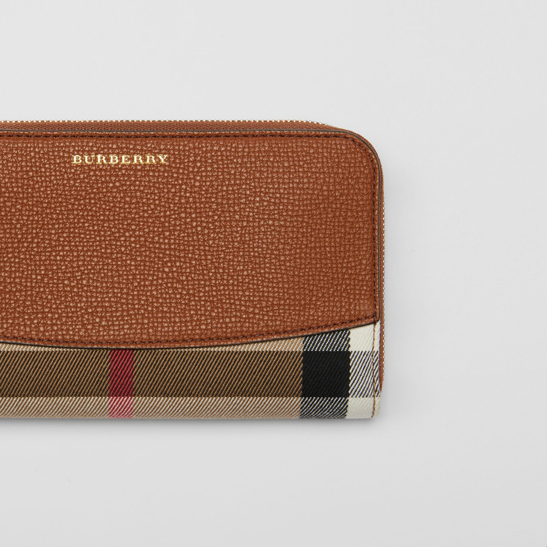 House Check and Leather Ziparound Wallet in Brown Ochre - Women | Burberry - gallery image 1
