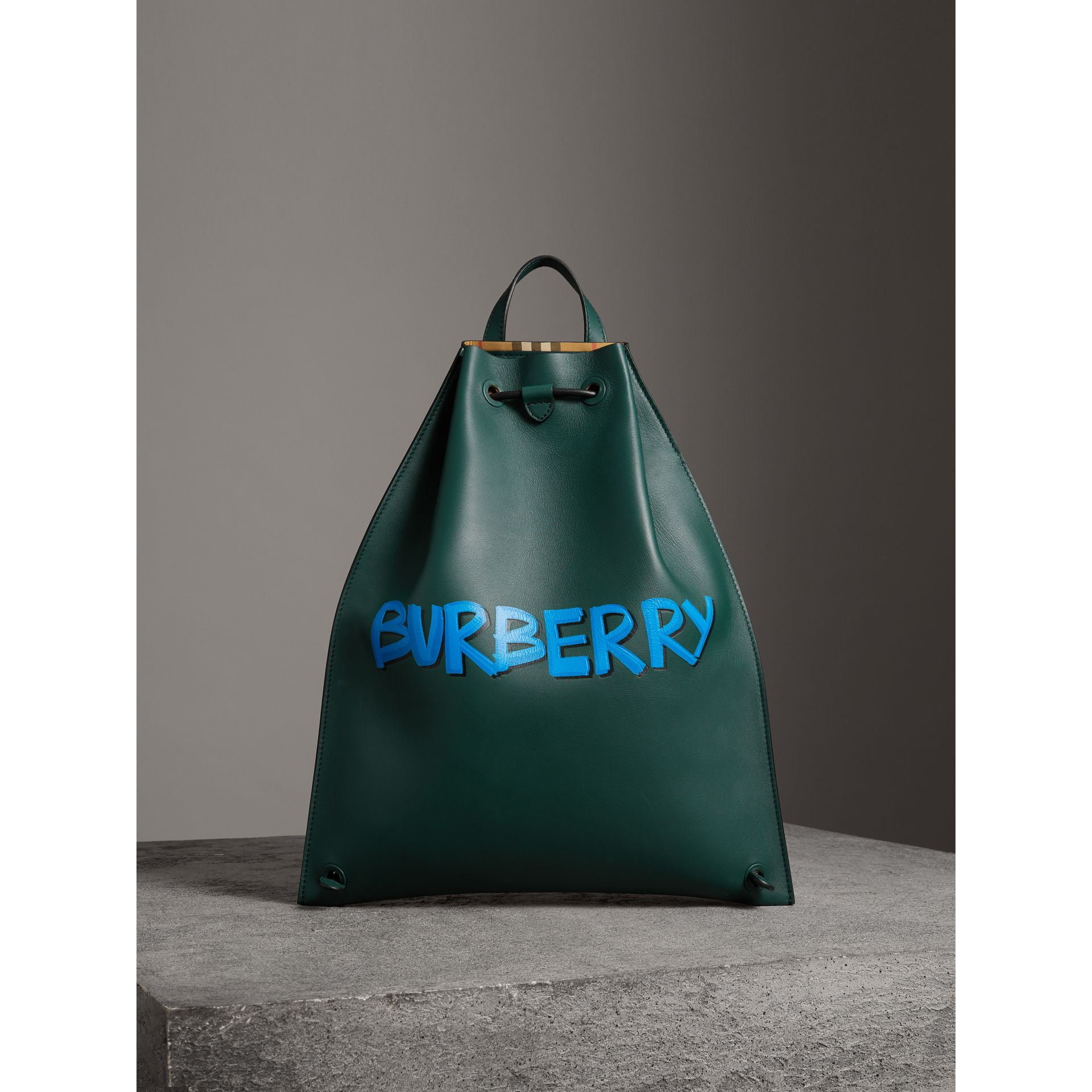 Graffiti Print Bonded Leather Drawcord Backpack in Deep Bottle Green - Men | Burberry Australia - gallery image 6