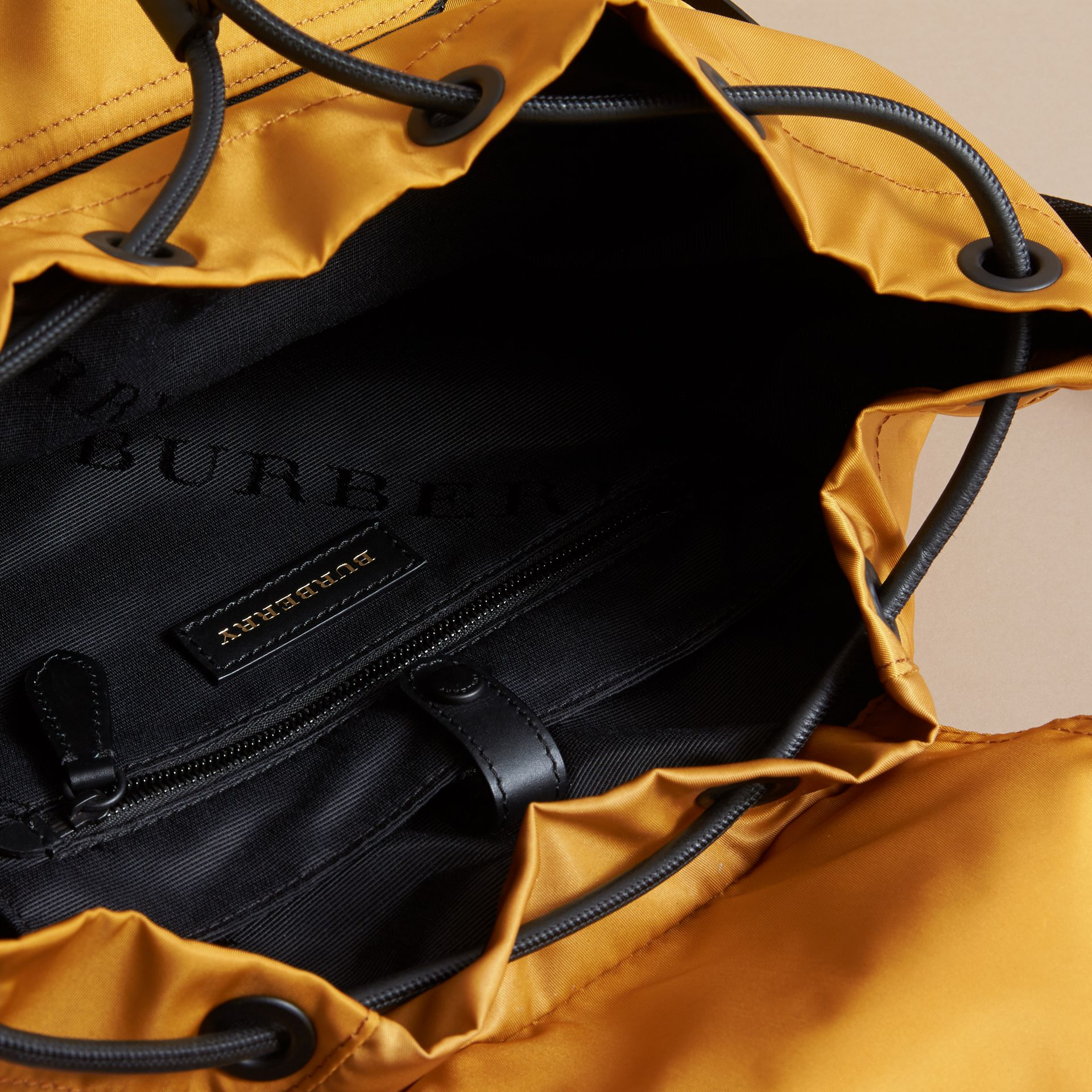 The Large Rucksack in Technical Nylon and Leather in Ochre Yellow - gallery image 5