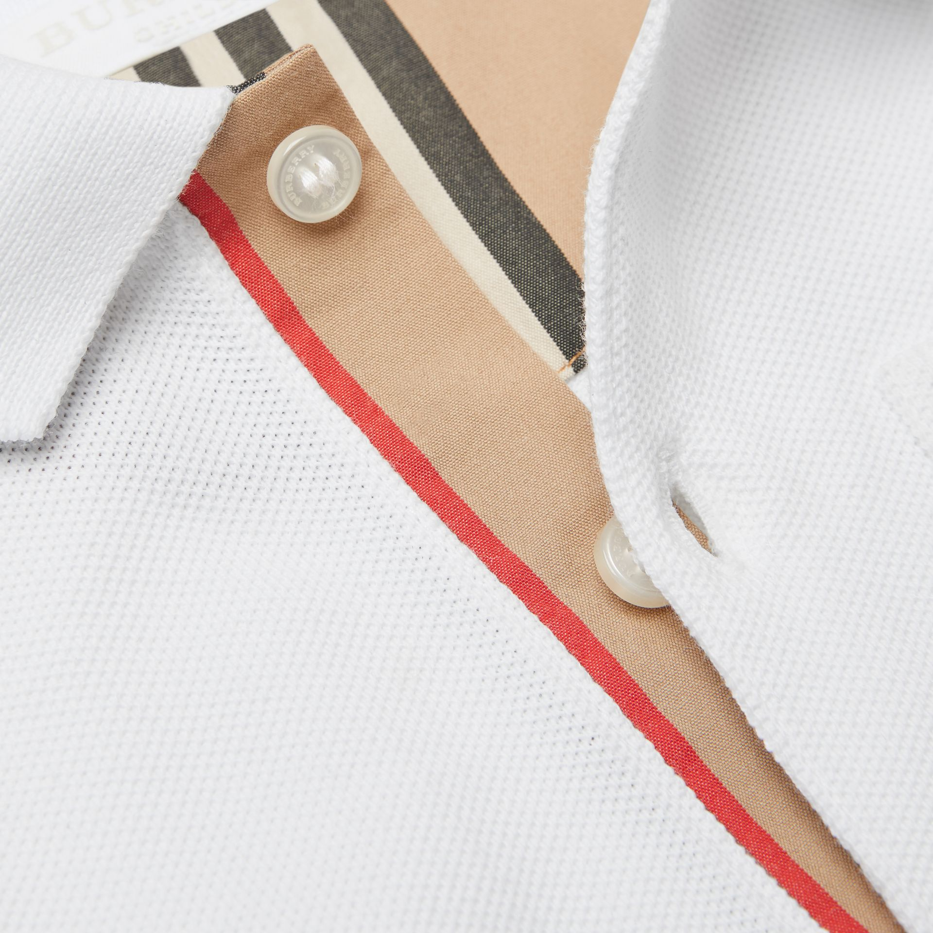 Icon Stripe Placket Cotton Piqué Polo Shirt in White - Children | Burberry - gallery image 1