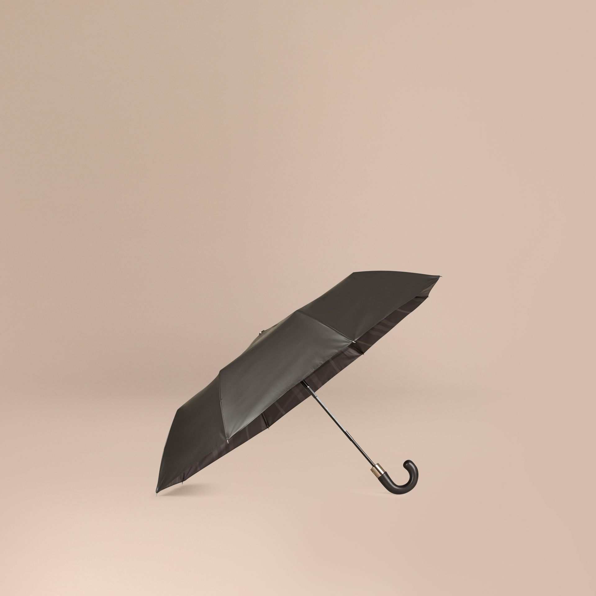 Check-lined Folding Umbrella in Dark Charcoal | Burberry - gallery image 1