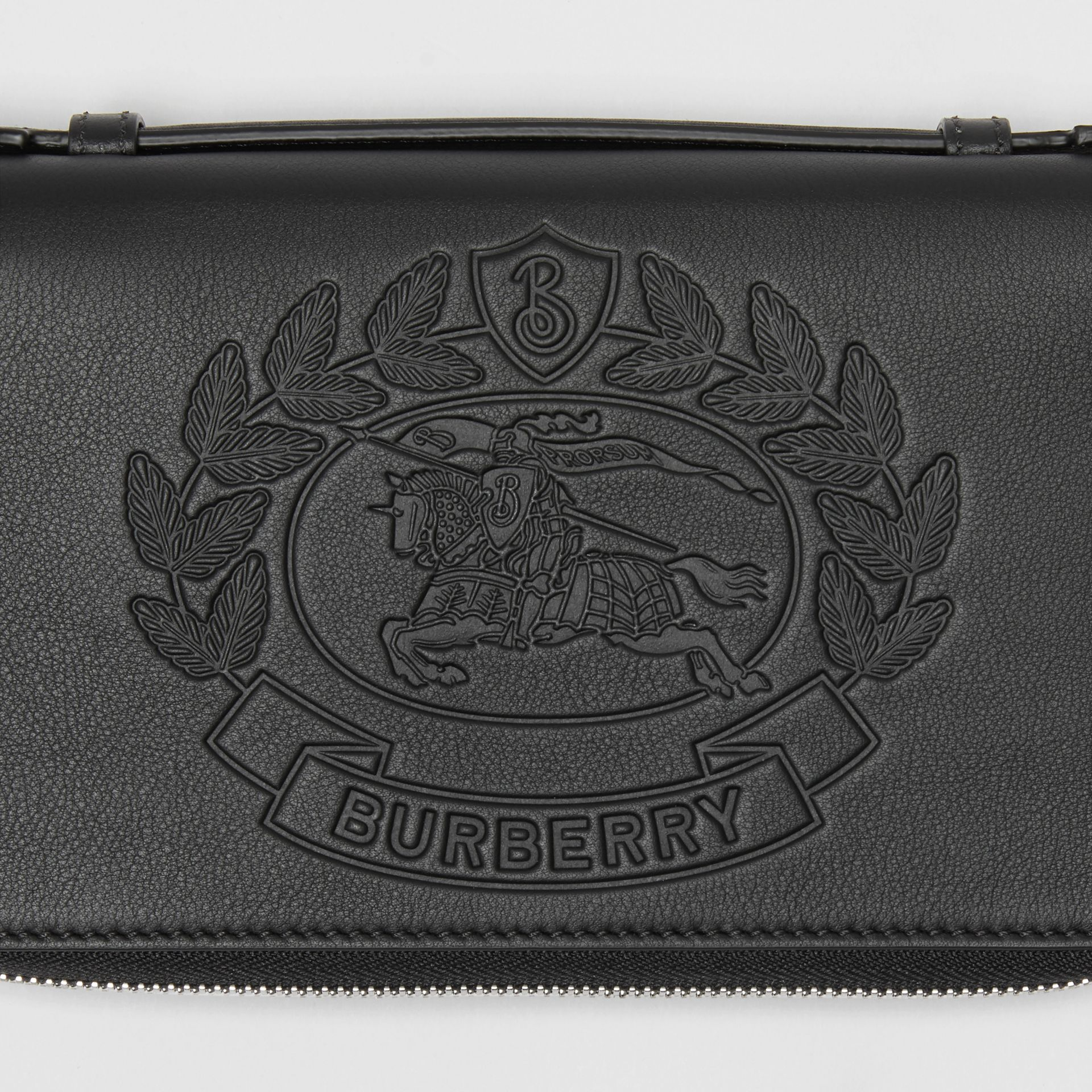 Embossed Crest Leather Travel Wallet in Black - Men | Burberry - gallery image 1