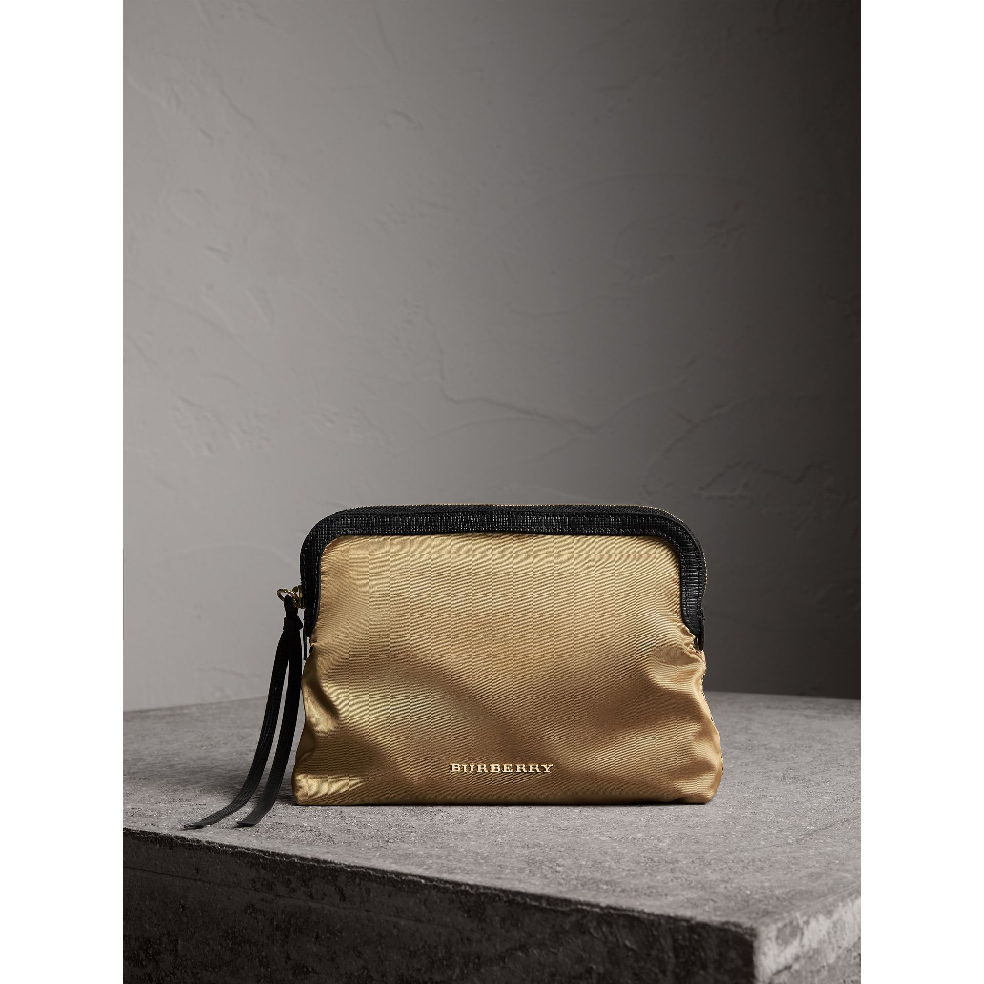 Large Zip-top Leather-trimmed Technical Nylon Pouch in Gold/black - Women | Burberry United Kingdom - gallery image 1