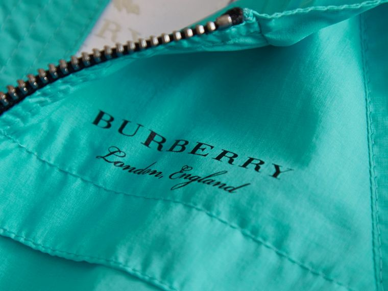 Showerproof Hooded Technical Jacket in Bright Turquoise | Burberry - cell image 1