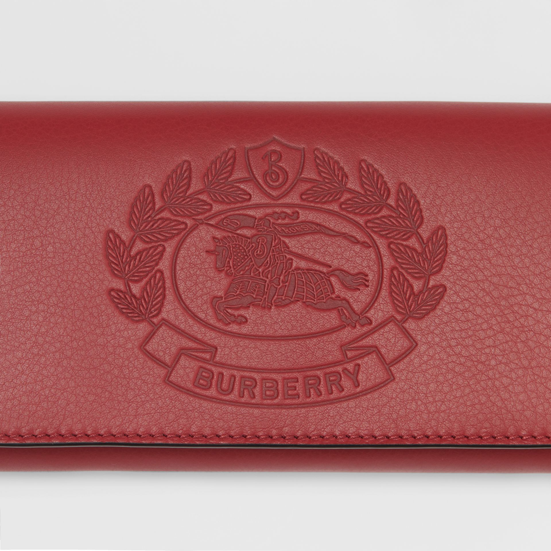 Embossed Crest Two-tone Leather Continental Wallet in Crimson - Women | Burberry Australia - gallery image 1