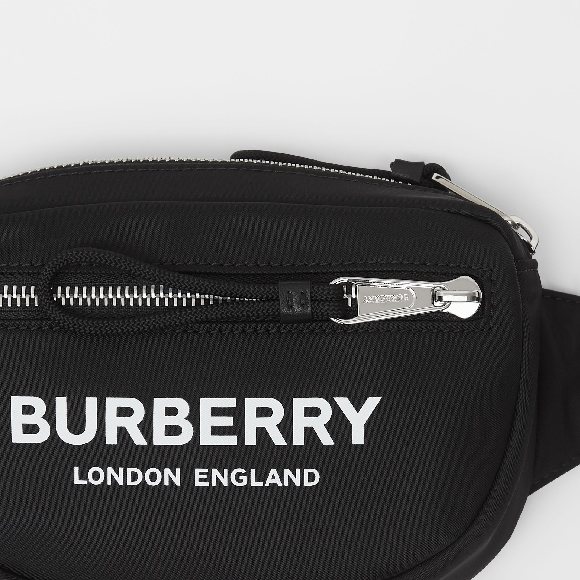 Small Logo Print ECONYL® Cannon Bum Bag in Black | Burberry - gallery image 1