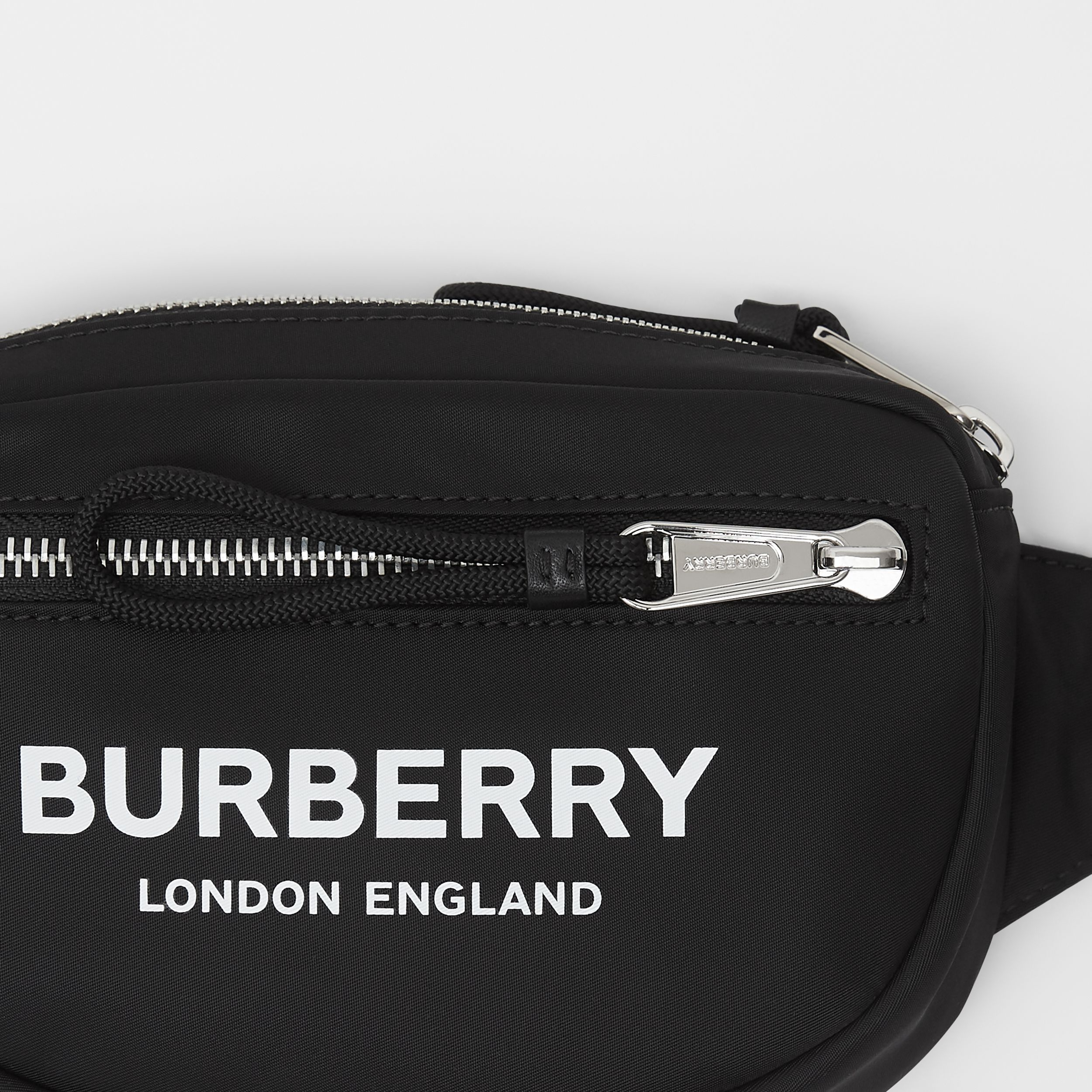 Small Logo Print ECONYL® Cannon Bum Bag in Black | Burberry United Kingdom - 2