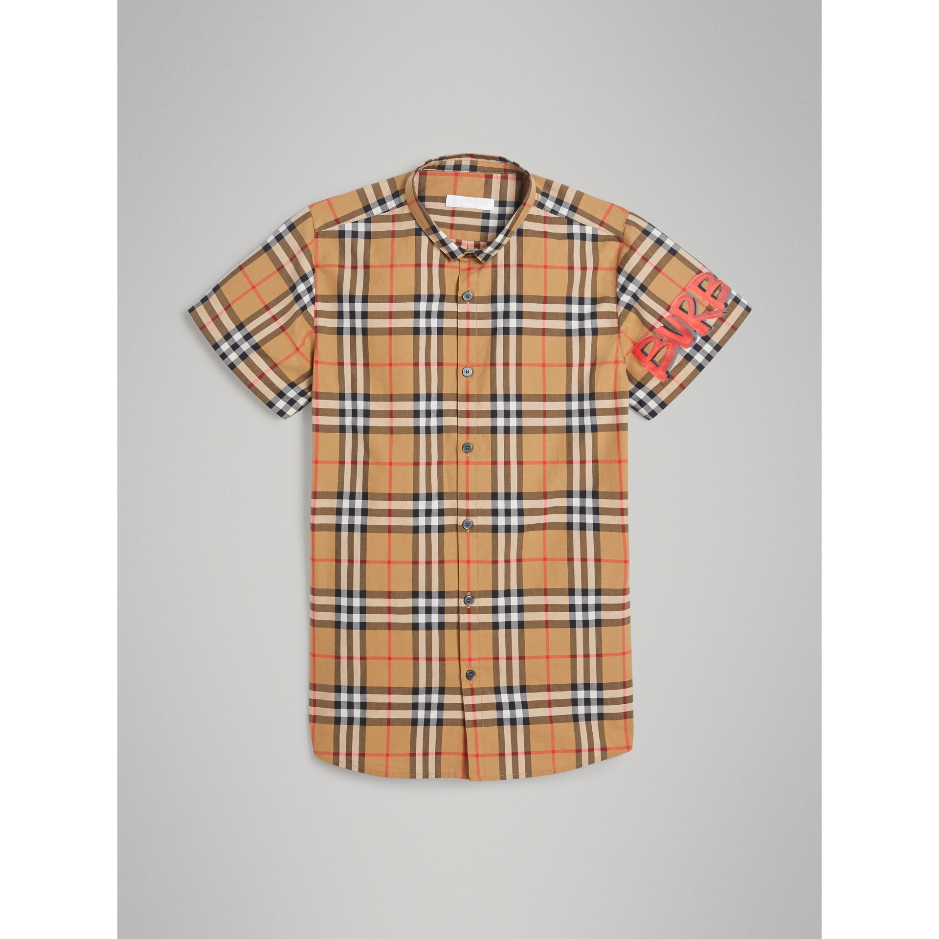 Short-sleeve Graffiti Print Check Cotton Shirt in Antique Yellow | Burberry - gallery image 0