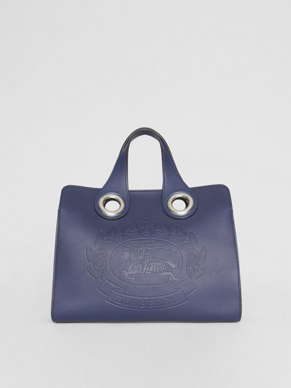 The Leather Crest Grommet Detail Tote in Regency Blue