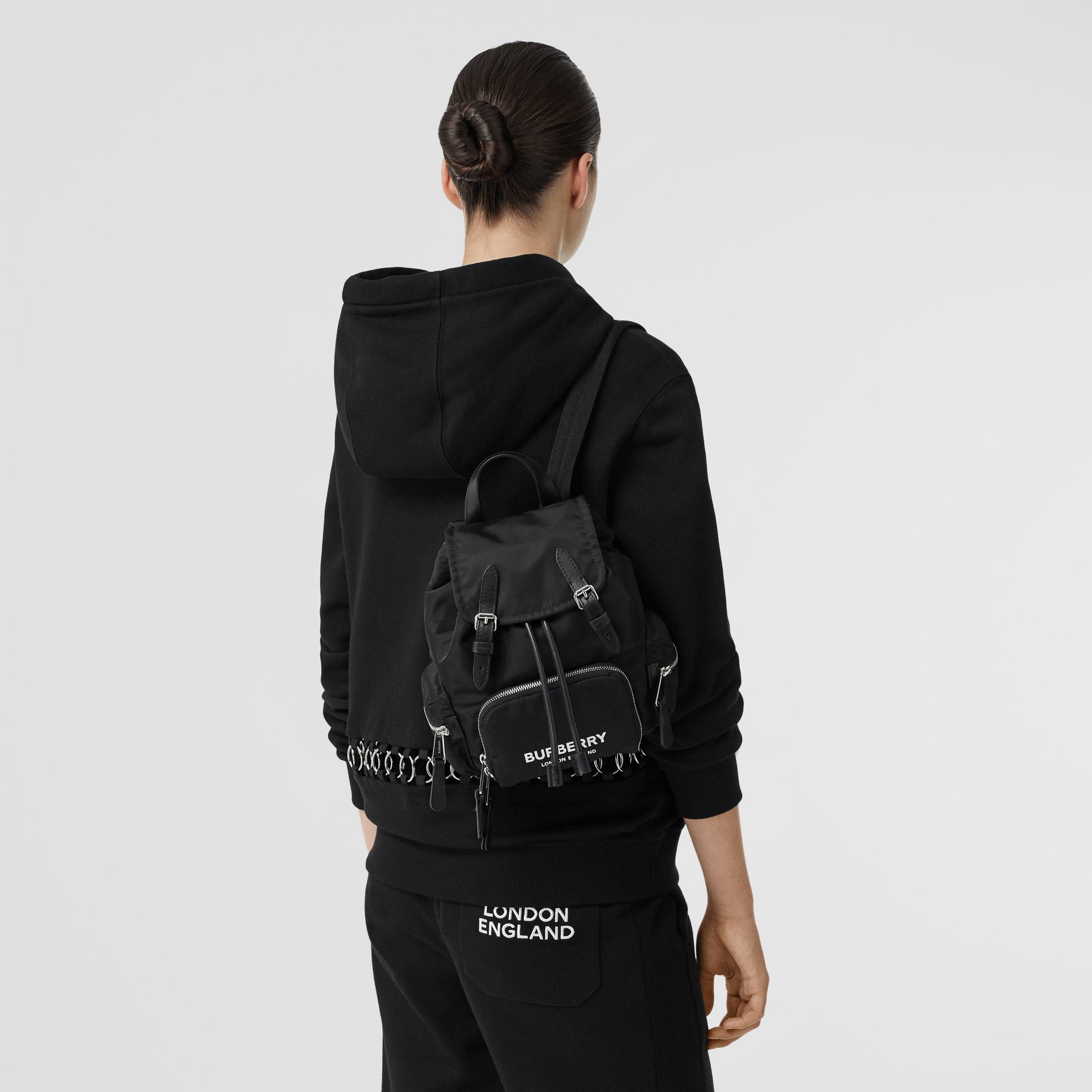 The Small Rucksack in Logo Print ECONYL® in Black - Women | Burberry United Kingdom - gallery image 2