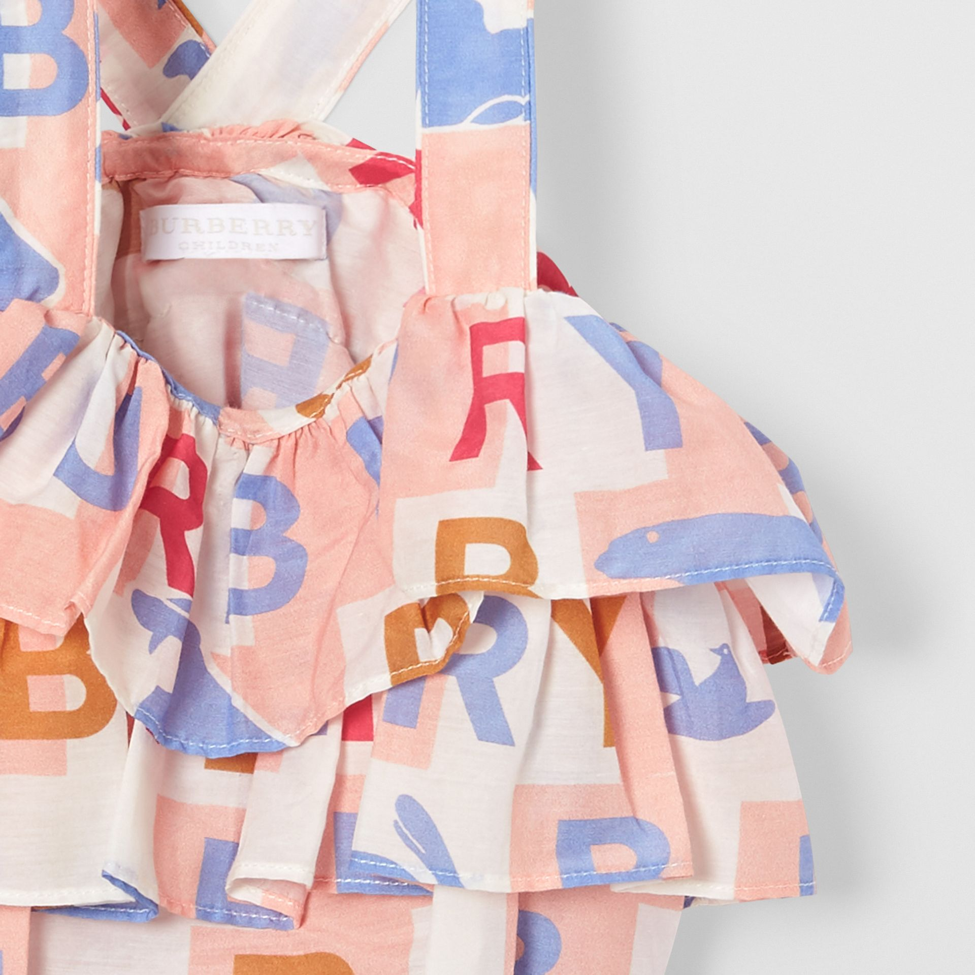 Ruffle Detail Logo Print Cotton Silk Playsuit in Pale Rose - Children | Burberry - gallery image 4