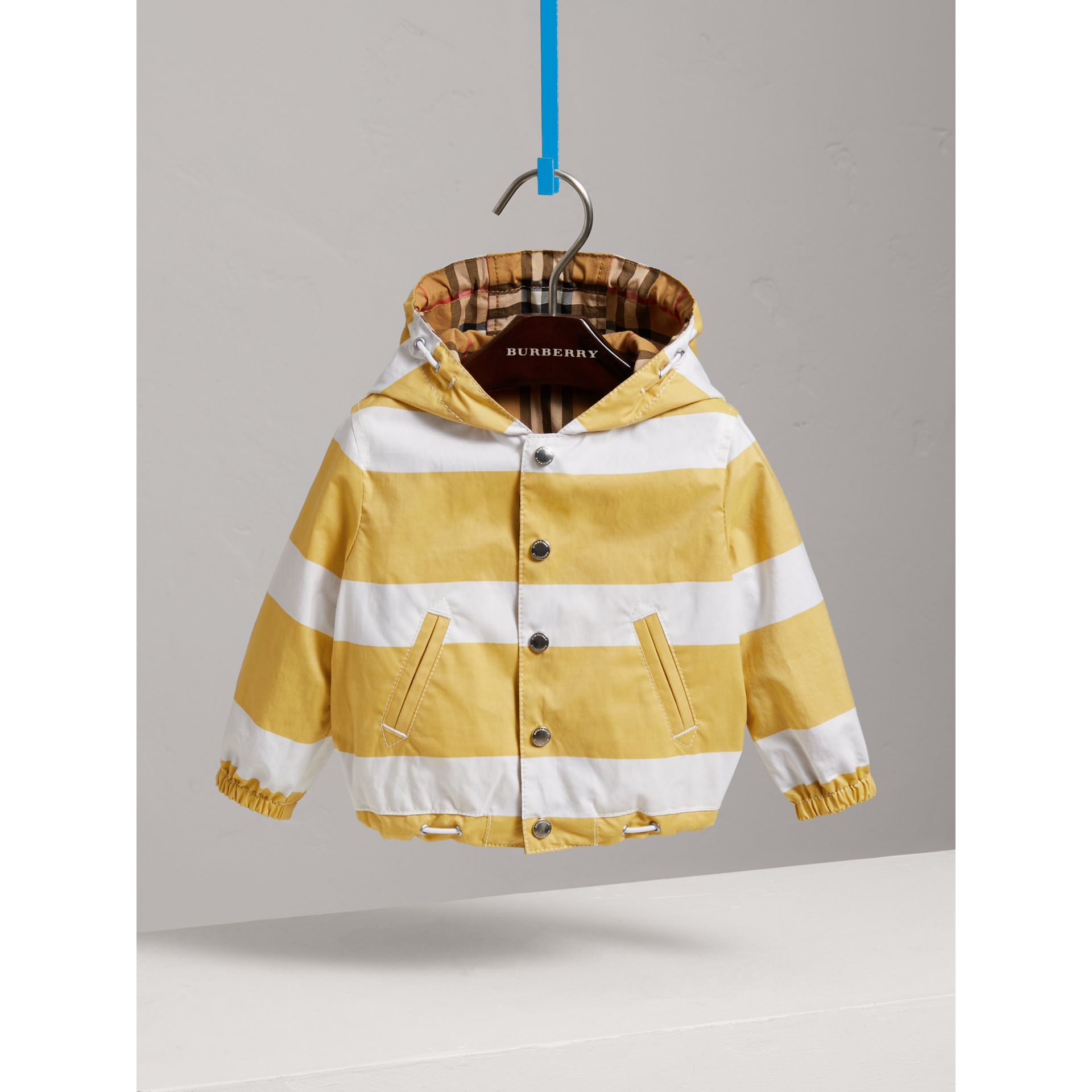 Reversible Stripe and Vintage Check Hooded Jacket in Larch Yellow/whte - Children | Burberry - gallery image 0
