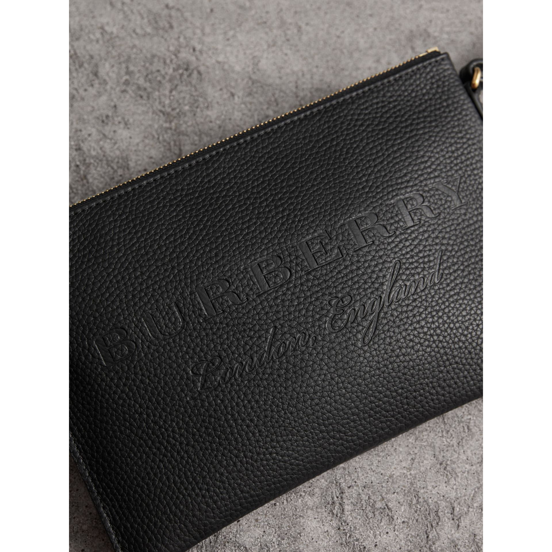 Embossed Leather Clutch Bag in Black - Women | Burberry Hong Kong - gallery image 1
