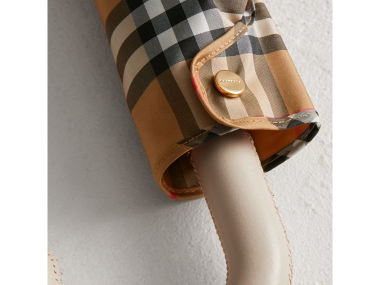 Vintage Check Folding Umbrella in Antique Yellow/limestone | Burberry Singapore - cell image 1