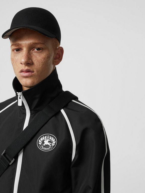 Crest Detail Funnel-neck Track Top in Black - Men | Burberry - cell image 1
