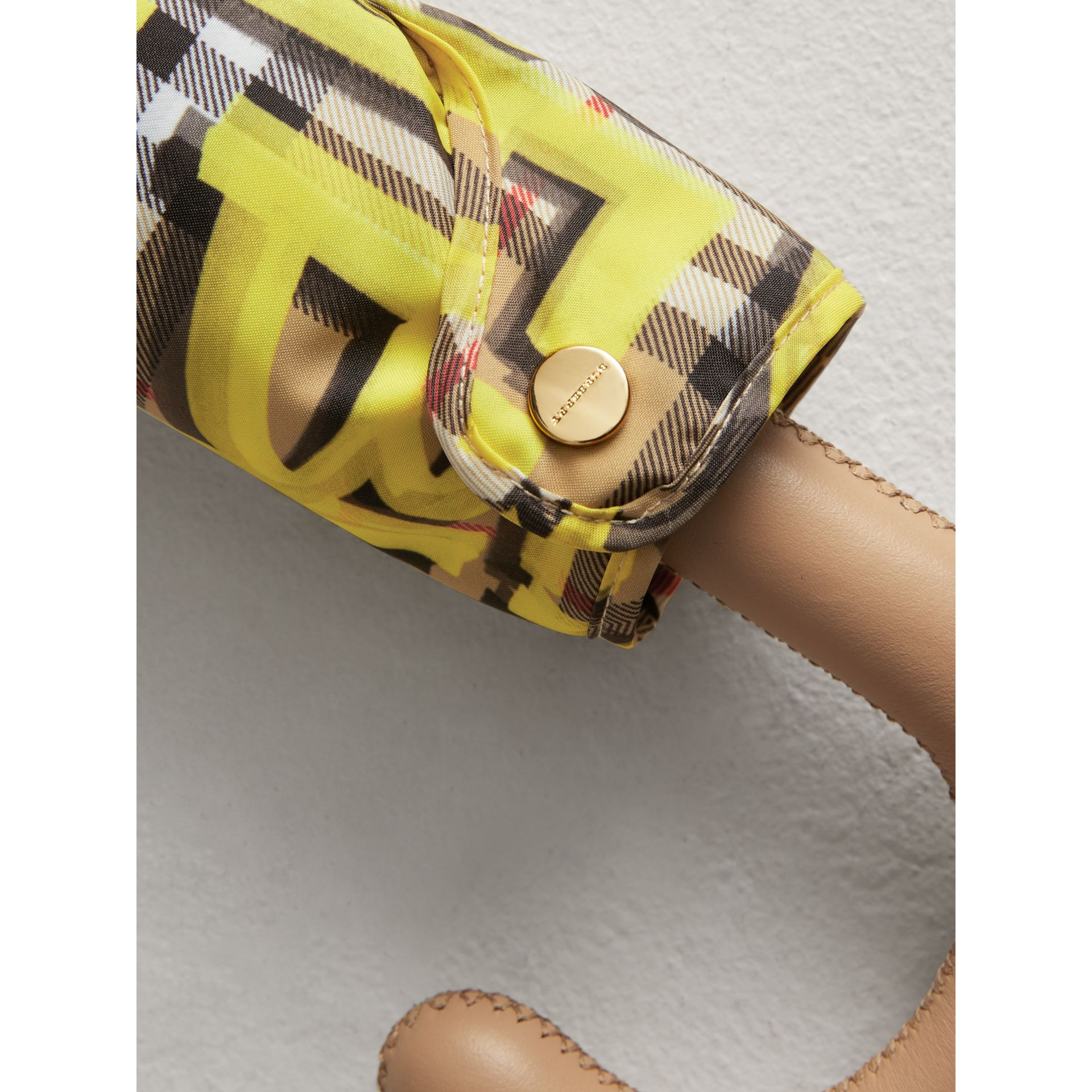 Graffiti Vintage Check Print Folding Umbrella in Yellow | Burberry Canada - gallery image 1