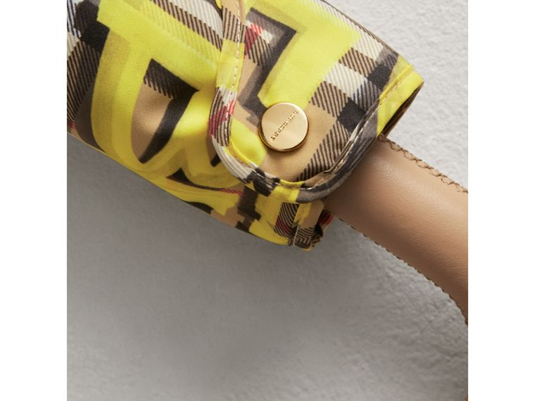 Graffiti Vintage Check Print Folding Umbrella in Yellow | Burberry - cell image 1