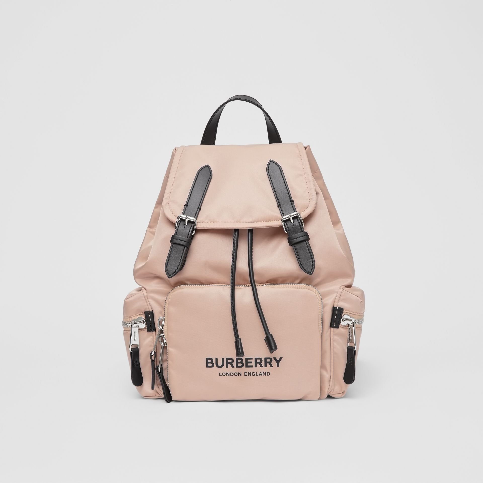 The Medium Rucksack in Logo Print ECONYL® in Rose Beige - Women | Burberry United Kingdom - gallery image 0
