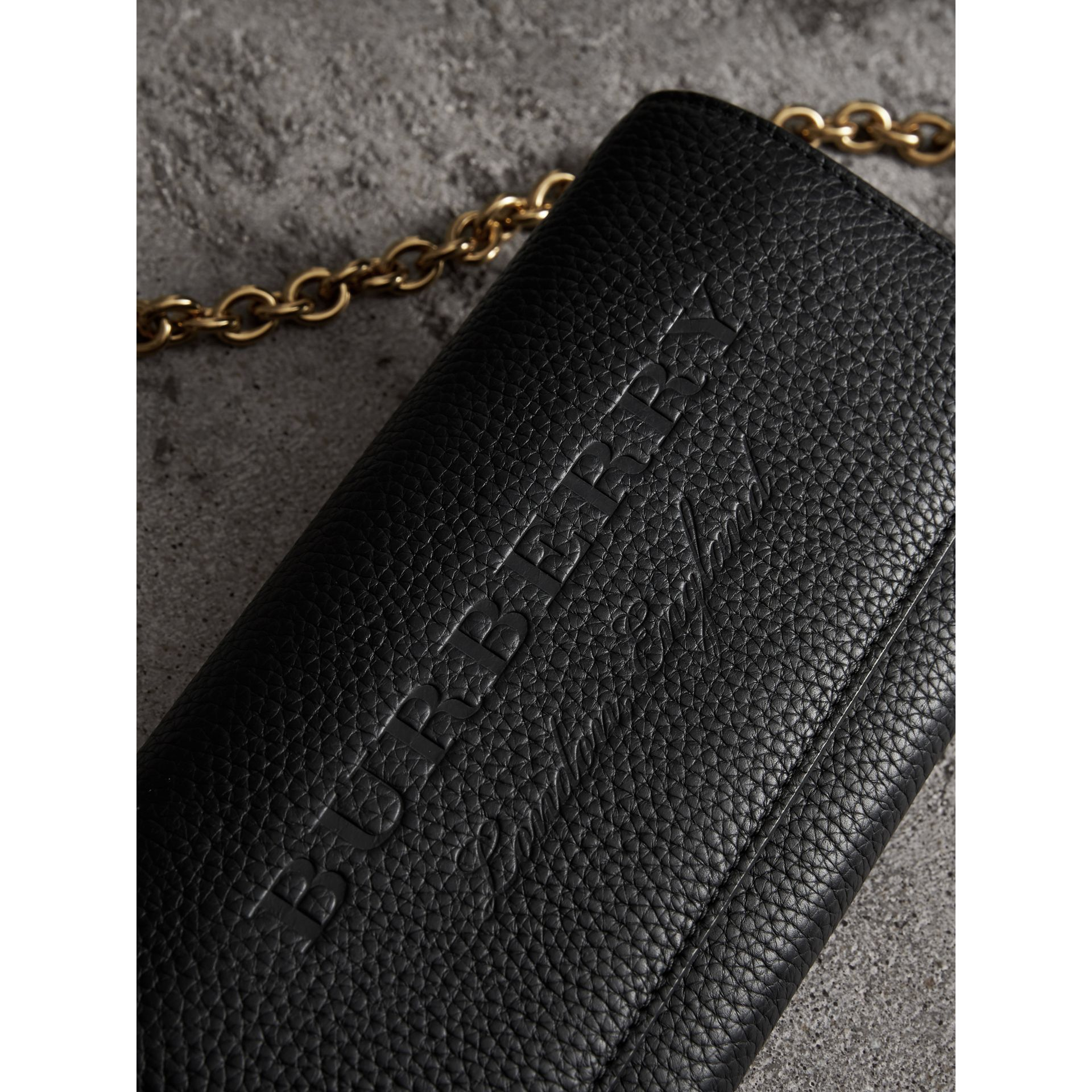 Embossed Leather Wallet with Chain in Black - Women | Burberry United States - gallery image 1