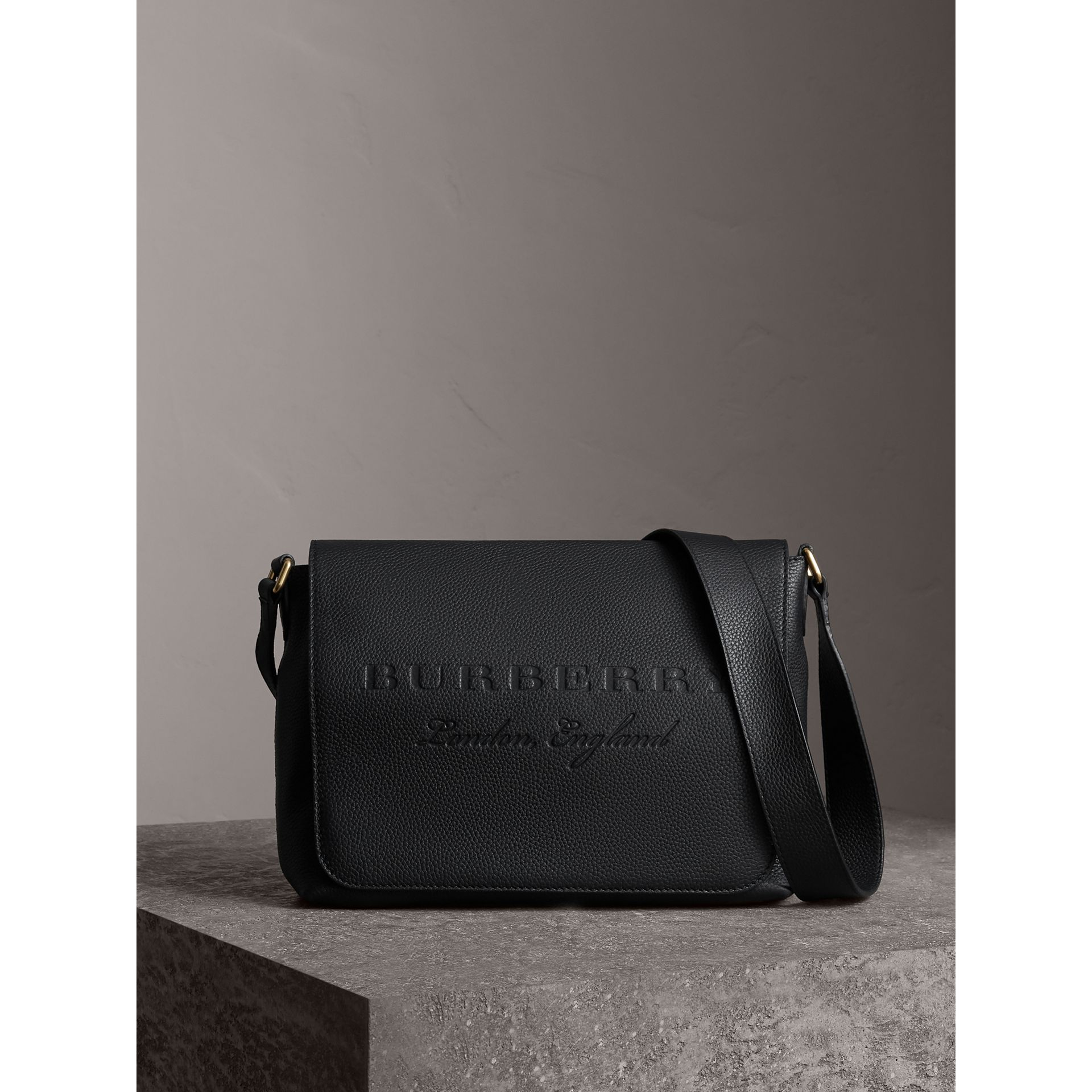 Medium Embossed Leather Messenger Bag in Black - Women | Burberry United Kingdom - gallery image 1