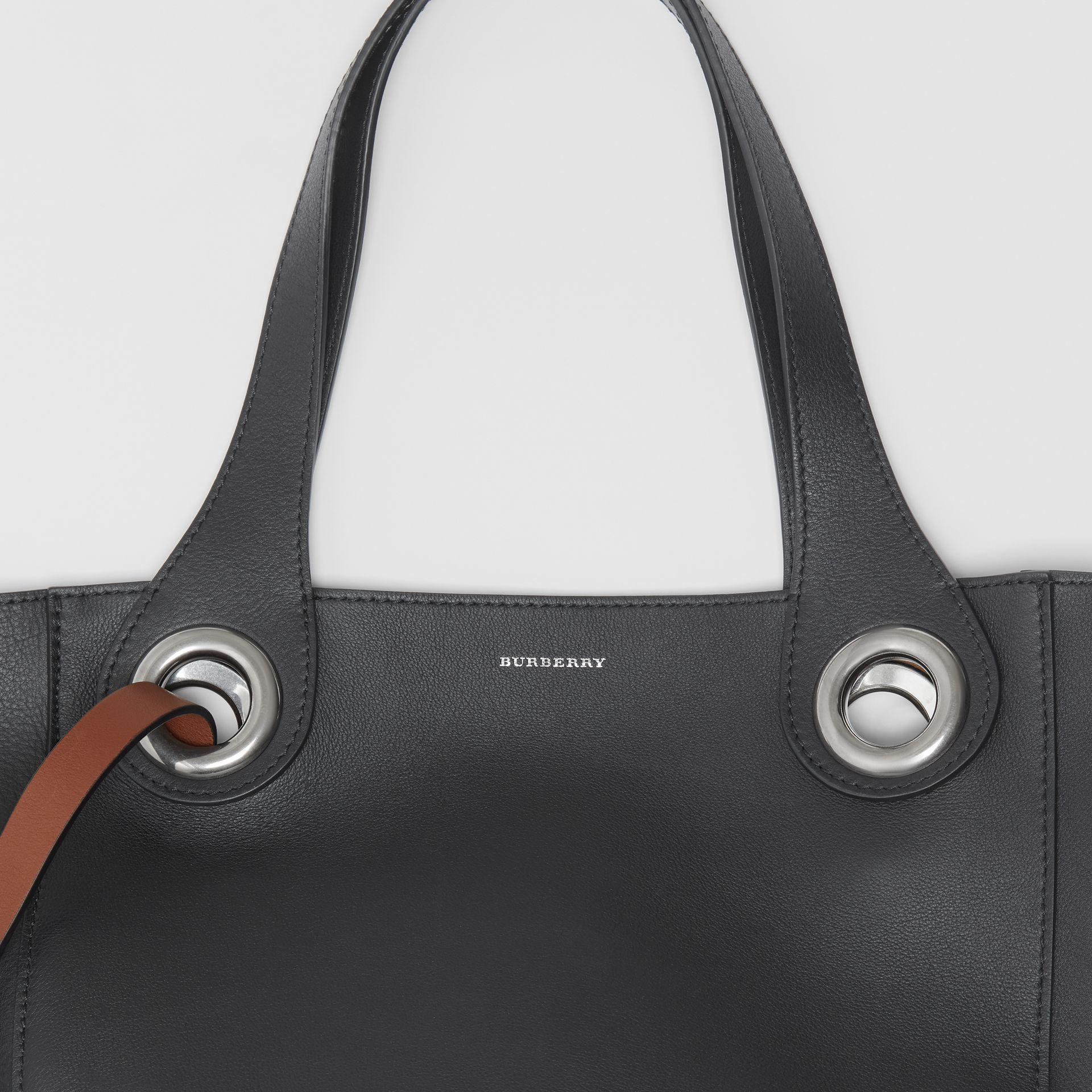 The Medium Leather Grommet Detail Tote in Black - Women | Burberry United Kingdom - gallery image 1