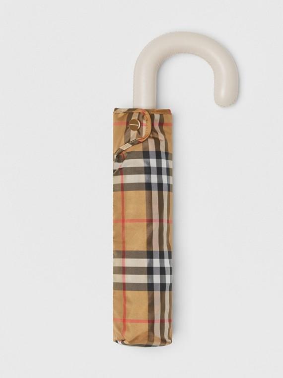 Taschenschirm mit Vintage Check-Muster (Antikgelb/kalksteinfarben)