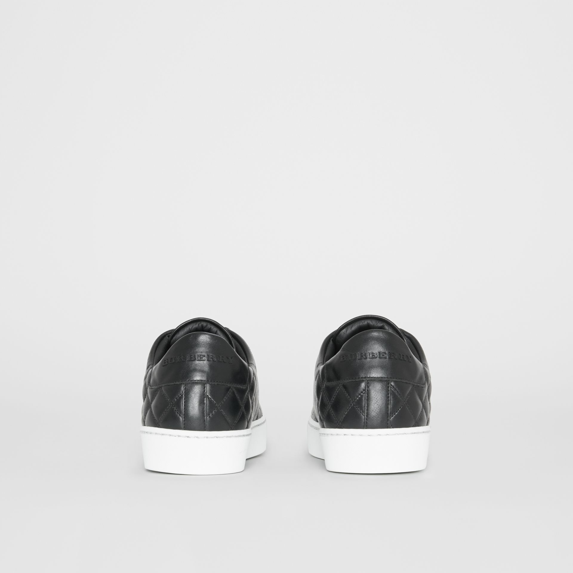 Check-quilted Leather Sneakers in Black - Women | Burberry Canada - gallery image 4