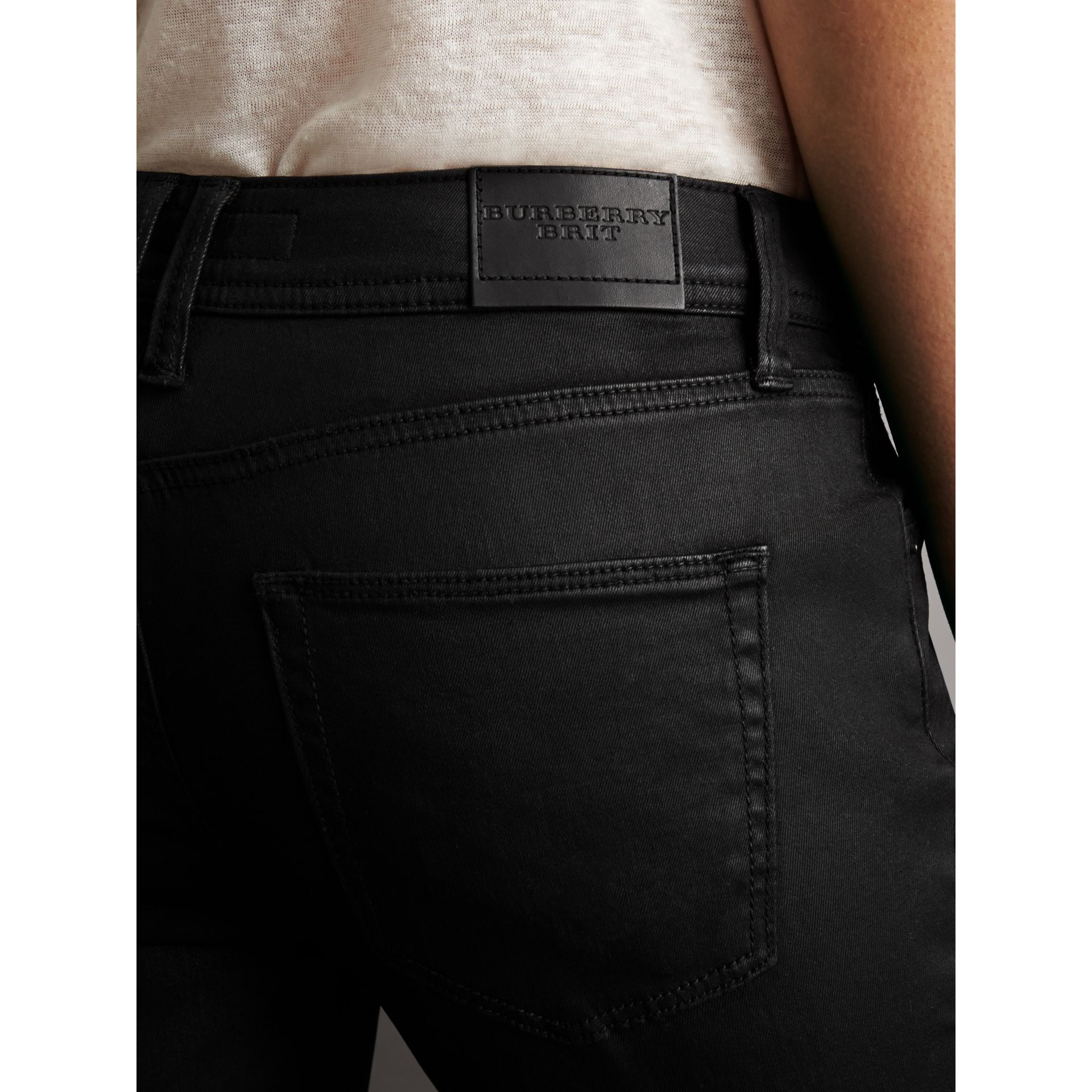Skinny Fit Low-rise Wax Coated Jeans in Black - Women | Burberry - gallery image 1