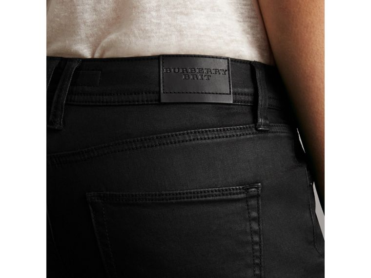 Skinny Fit Low-rise Wax Coated Jeans in Black - Women | Burberry United Kingdom - cell image 1