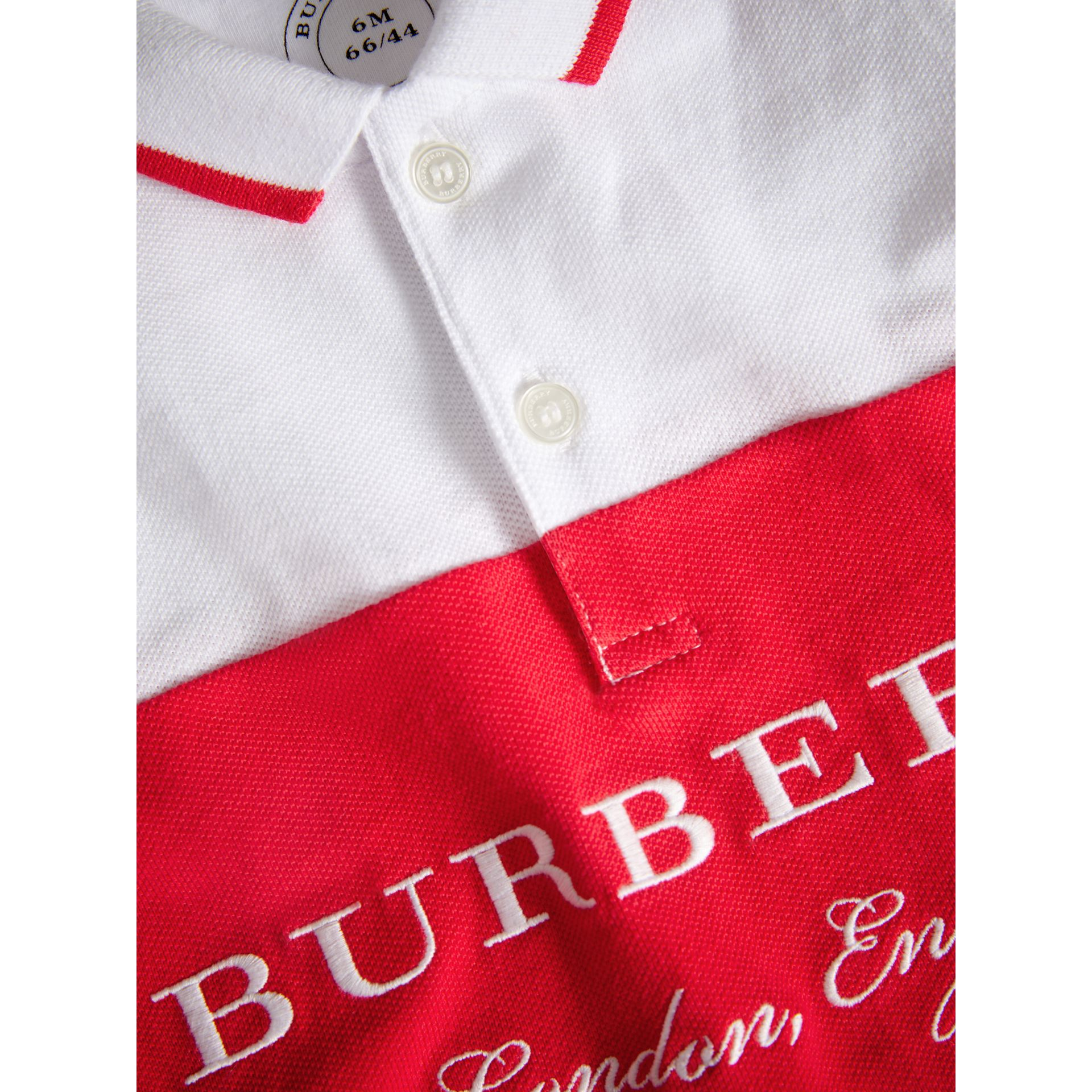 Tipped Cotton Piqué Polo Shirt in Bright Orange Red | Burberry Canada - gallery image 1