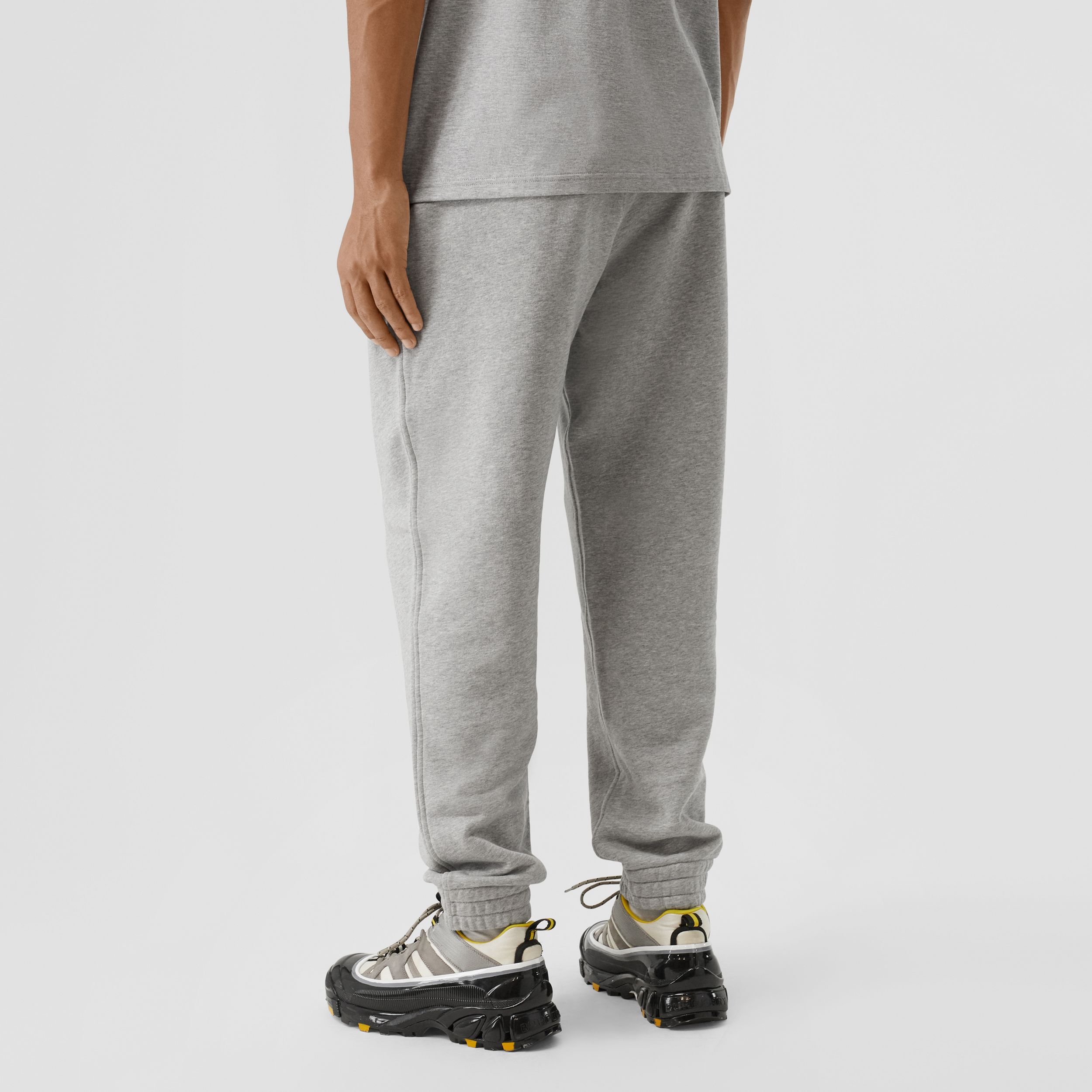 Contrast Logo Graphic Cotton Trackpants in Pale Grey Melange - Men | Burberry - 3