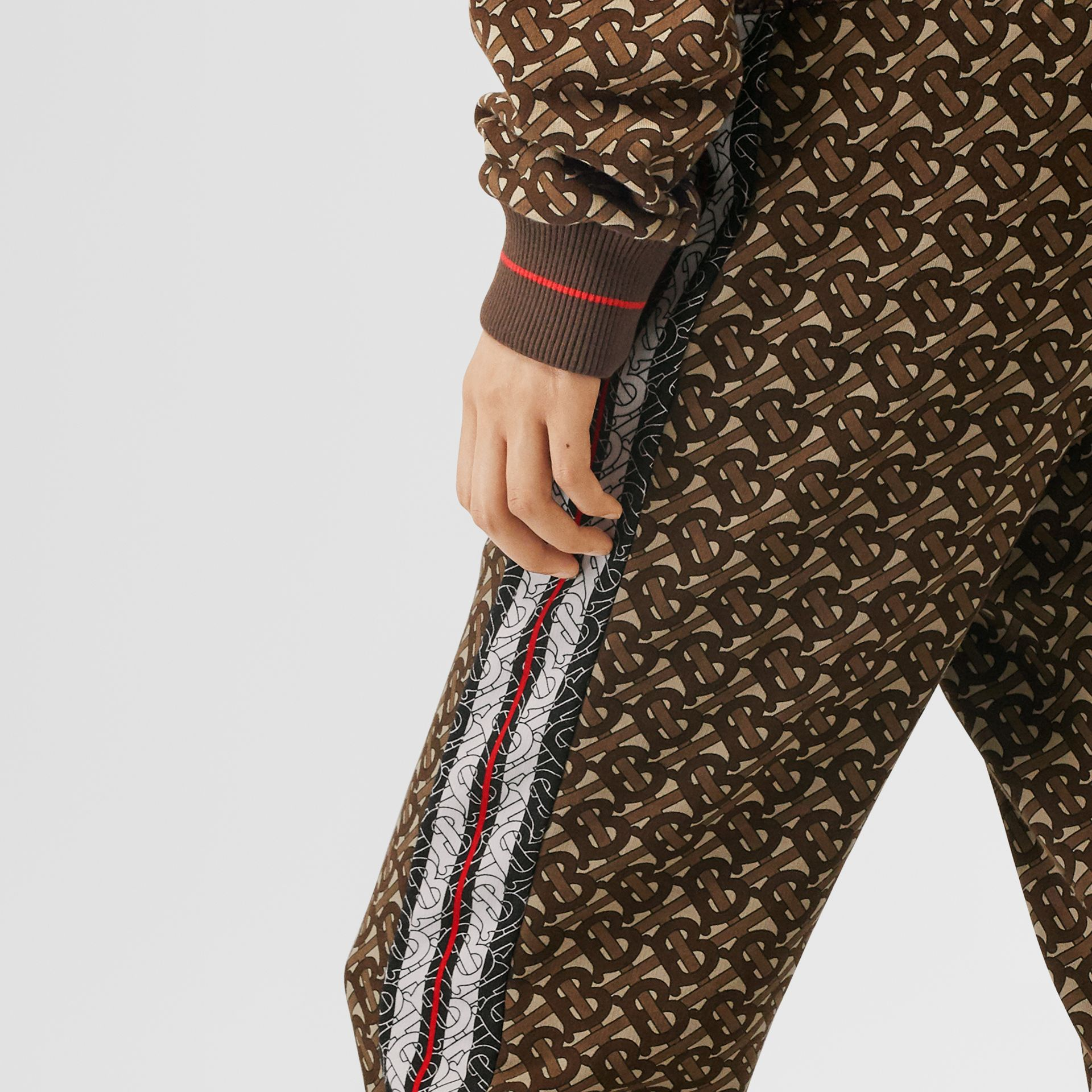 Monogram Stripe Print Cotton Trackpants in Bridle Brown - Women | Burberry - gallery image 1