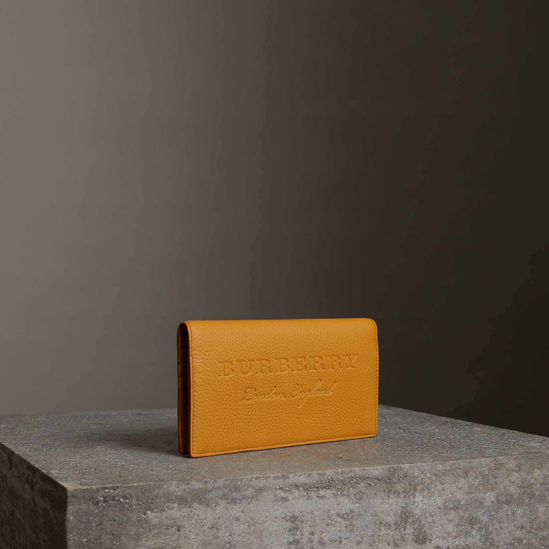 Embossed Leather Continental Wallet in Ochre Yellow | Burberry United Kingdom - gallery image 0