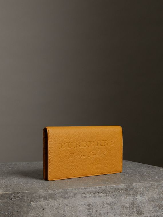 Embossed Leather Continental Wallet in Ochre Yellow