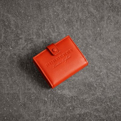 Embossed Leather Folding Wallet by Burberry