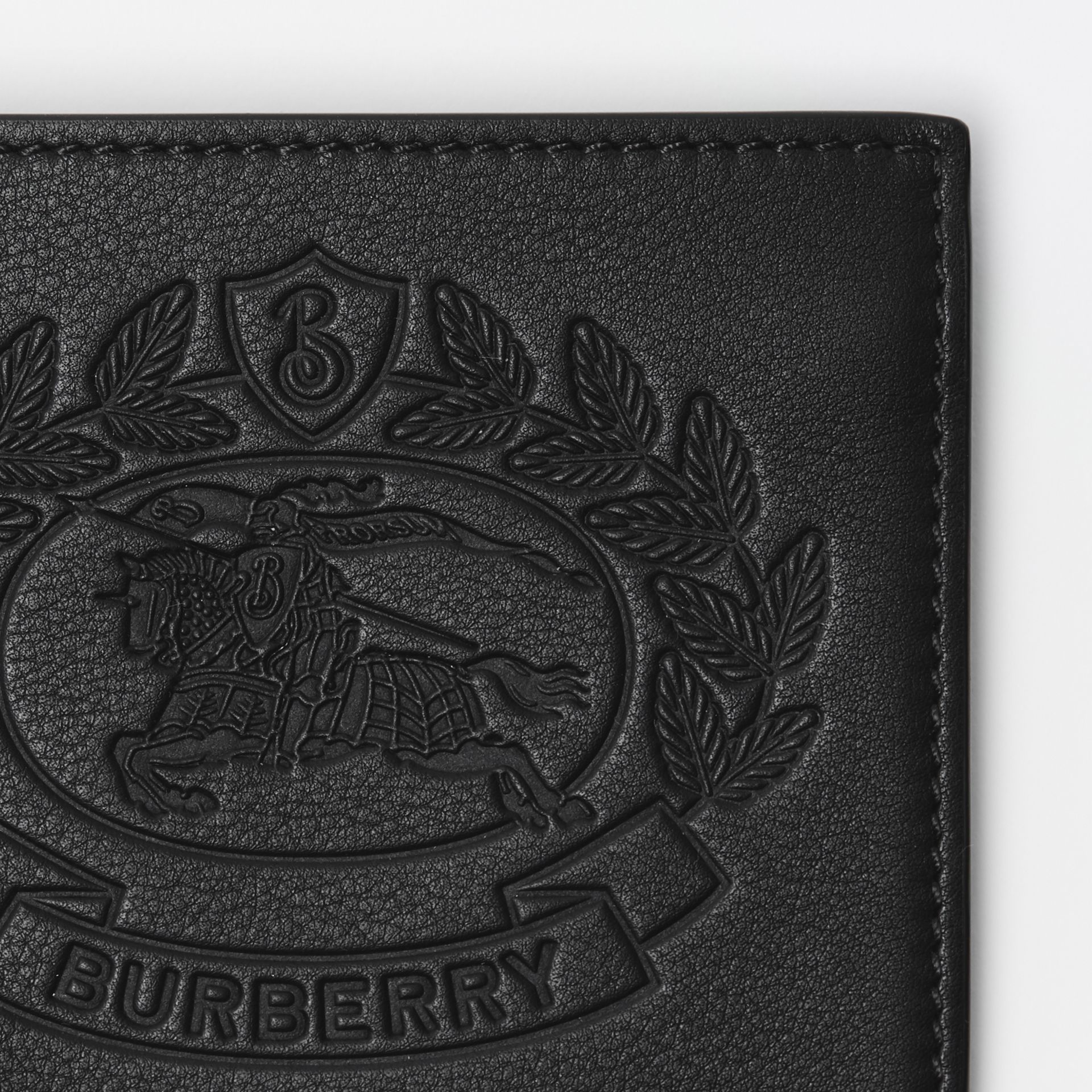 Embossed Crest Leather International Bifold Wallet in Black - Men | Burberry - gallery image 1