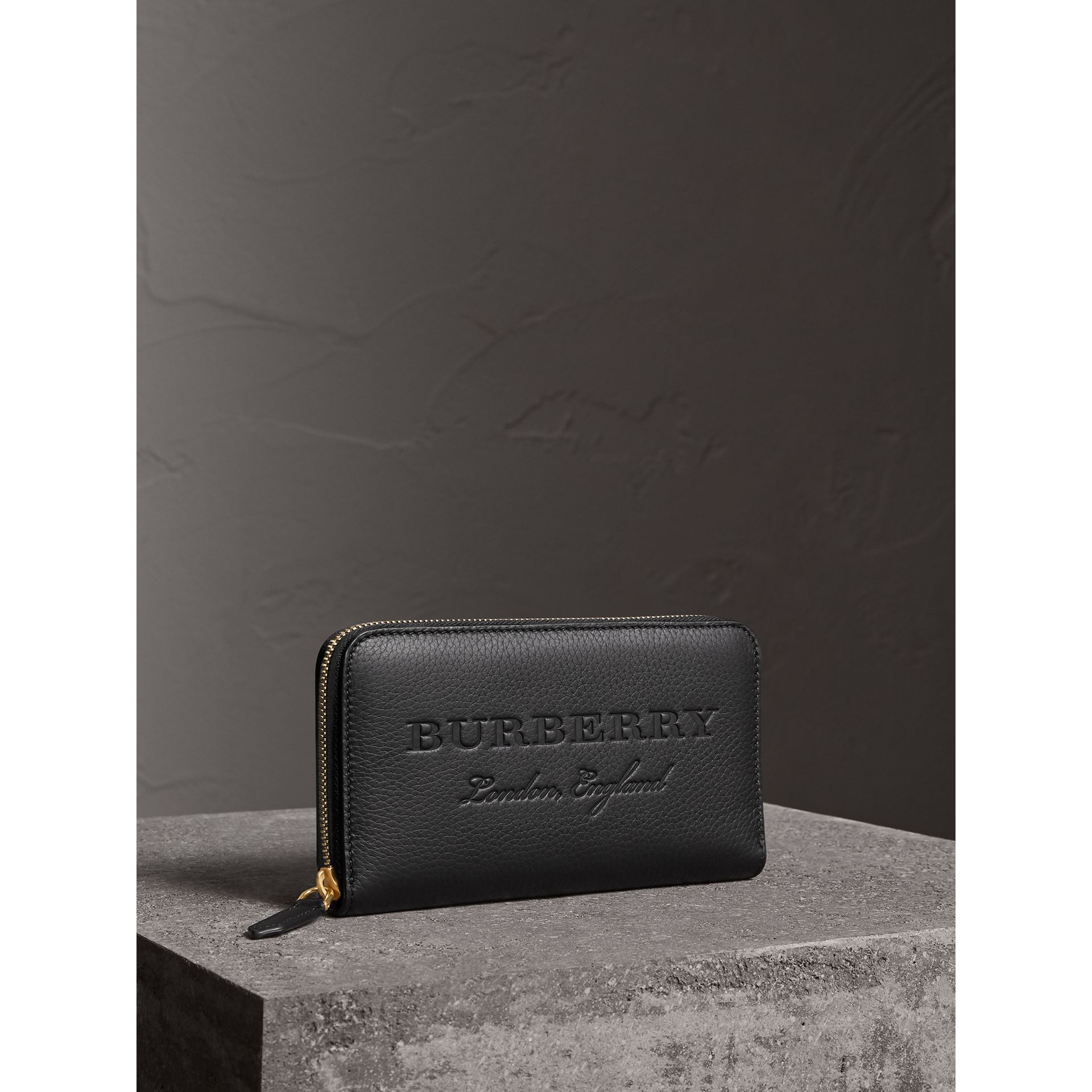 Embossed Leather Ziparound Wallet in Black - Women | Burberry - gallery image 1