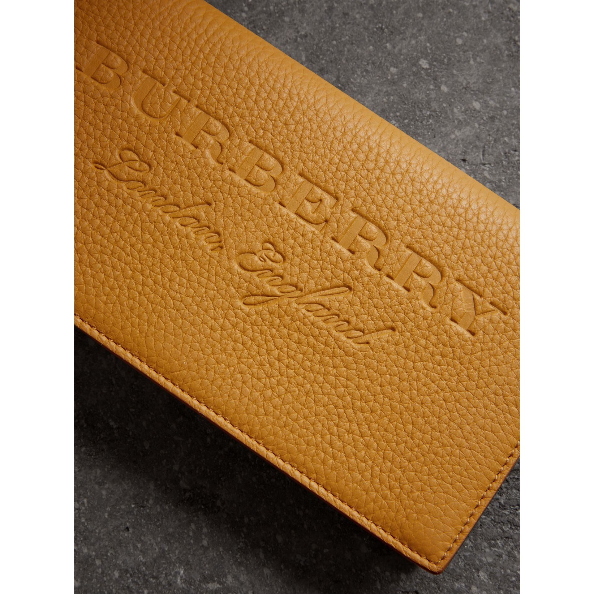 Embossed Leather Continental Wallet in Ochre Yellow | Burberry - gallery image 1
