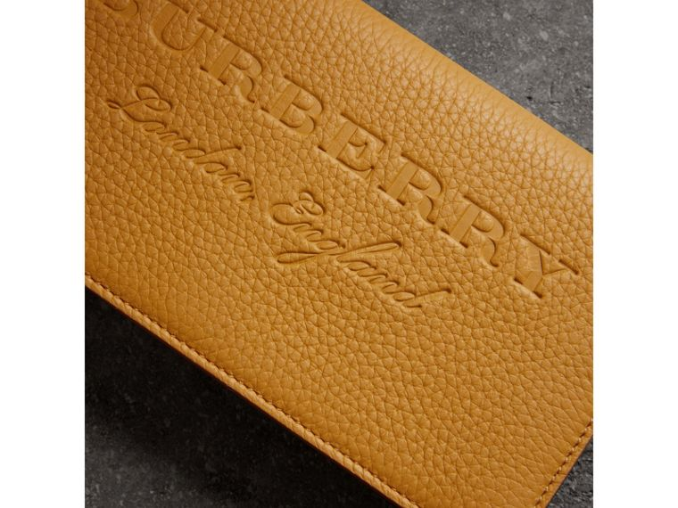 Embossed Leather Continental Wallet in Ochre Yellow | Burberry - cell image 1