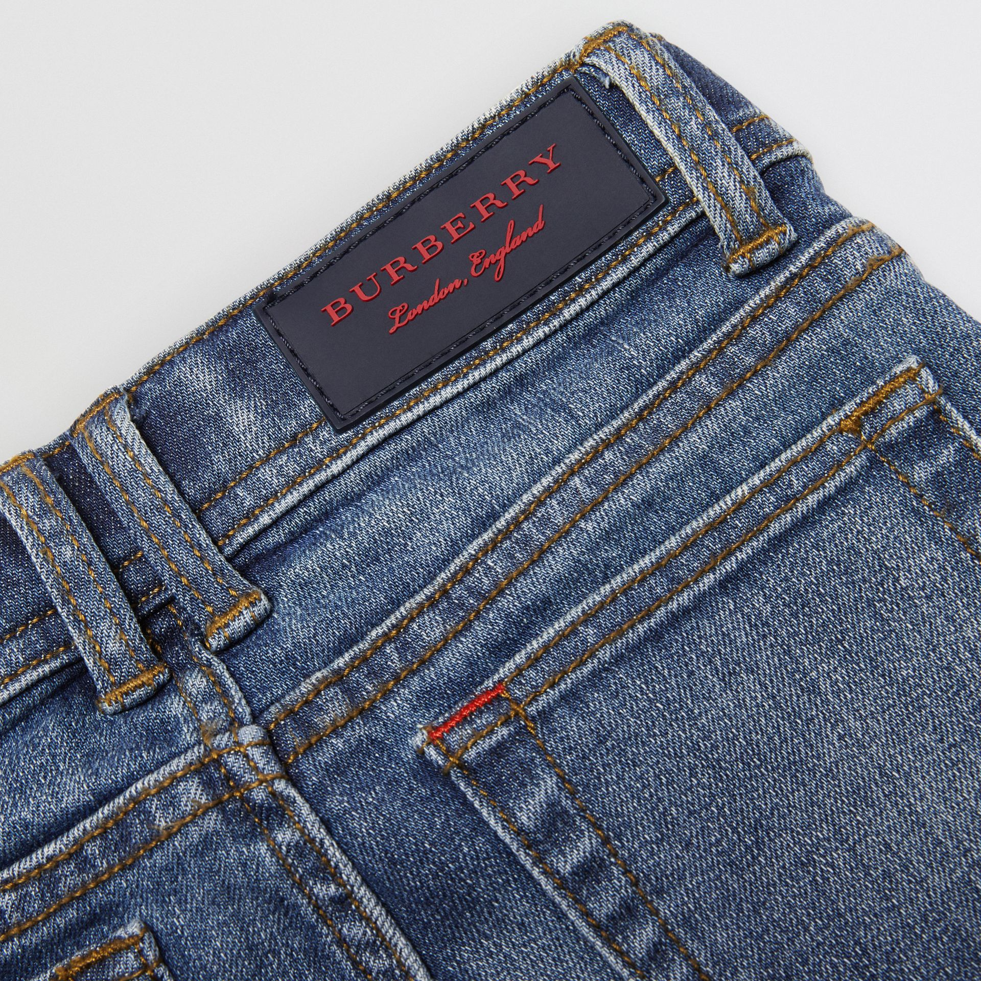 Skinny Fit Stretch Denim Jeans in Mid Indigo - Girl | Burberry Canada - gallery image 1