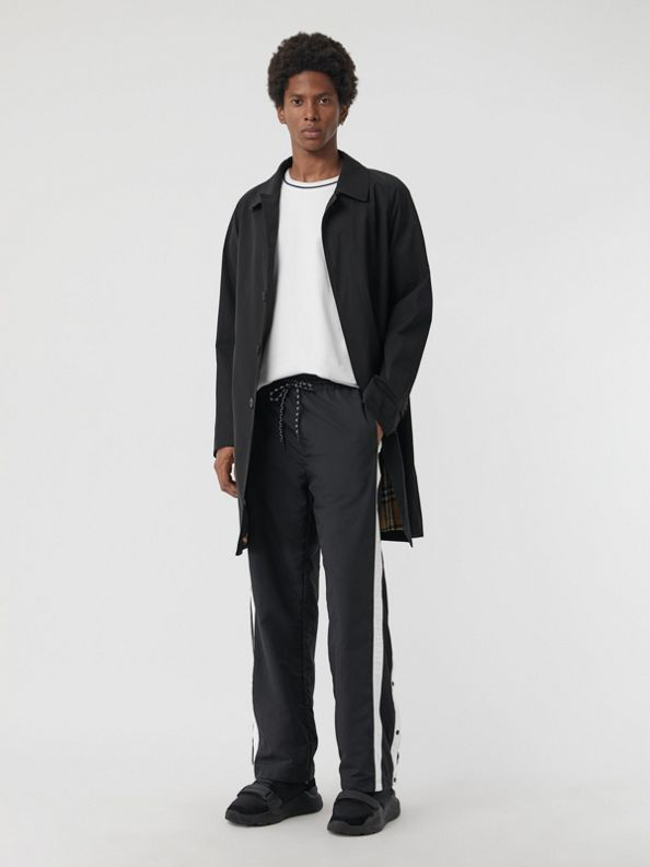 Pantalones deportivos en tejido jersey con franjas laterales (Negro)
