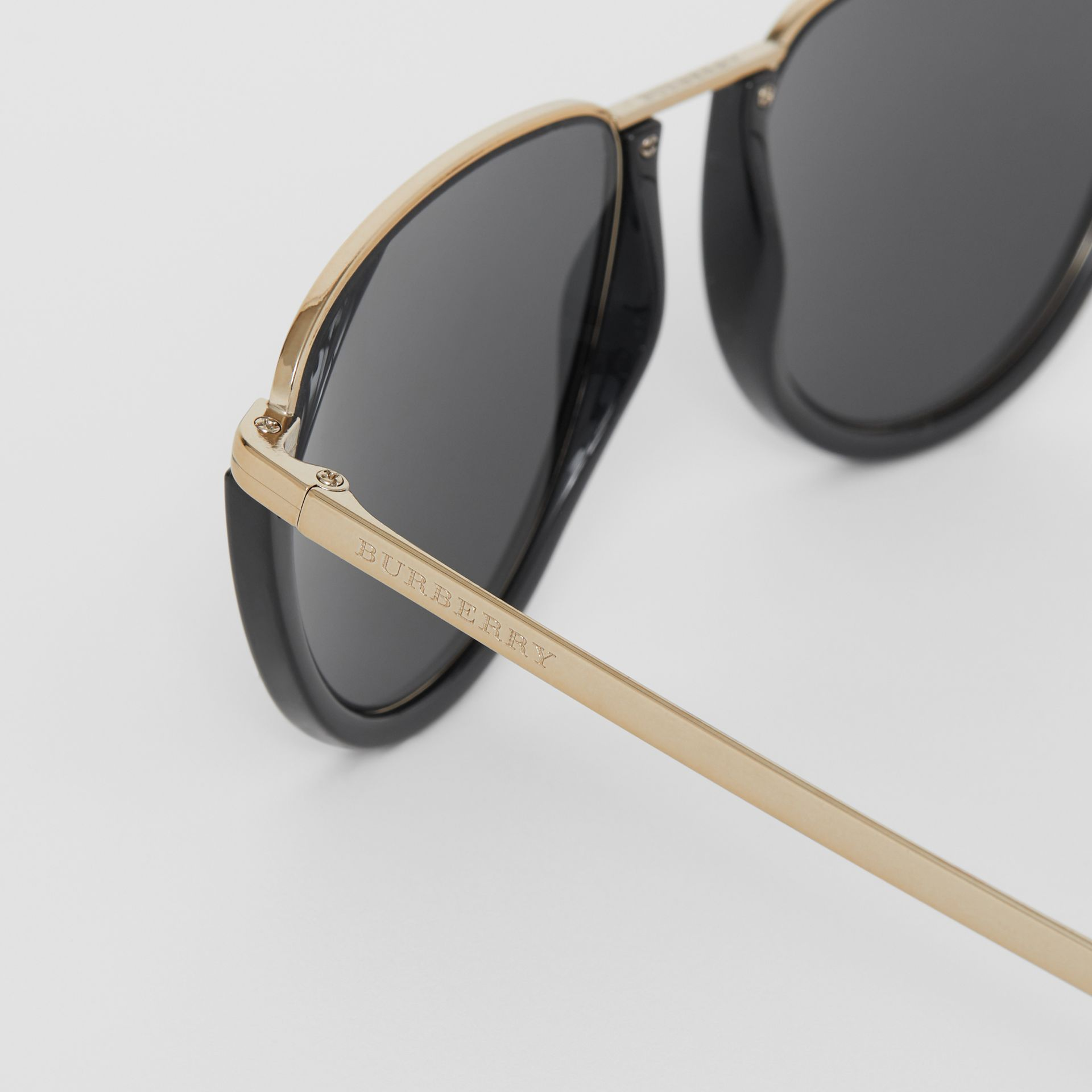 Half Moon Pilot Round Frame Sunglasses in Black - Women | Burberry Singapore - gallery image 1