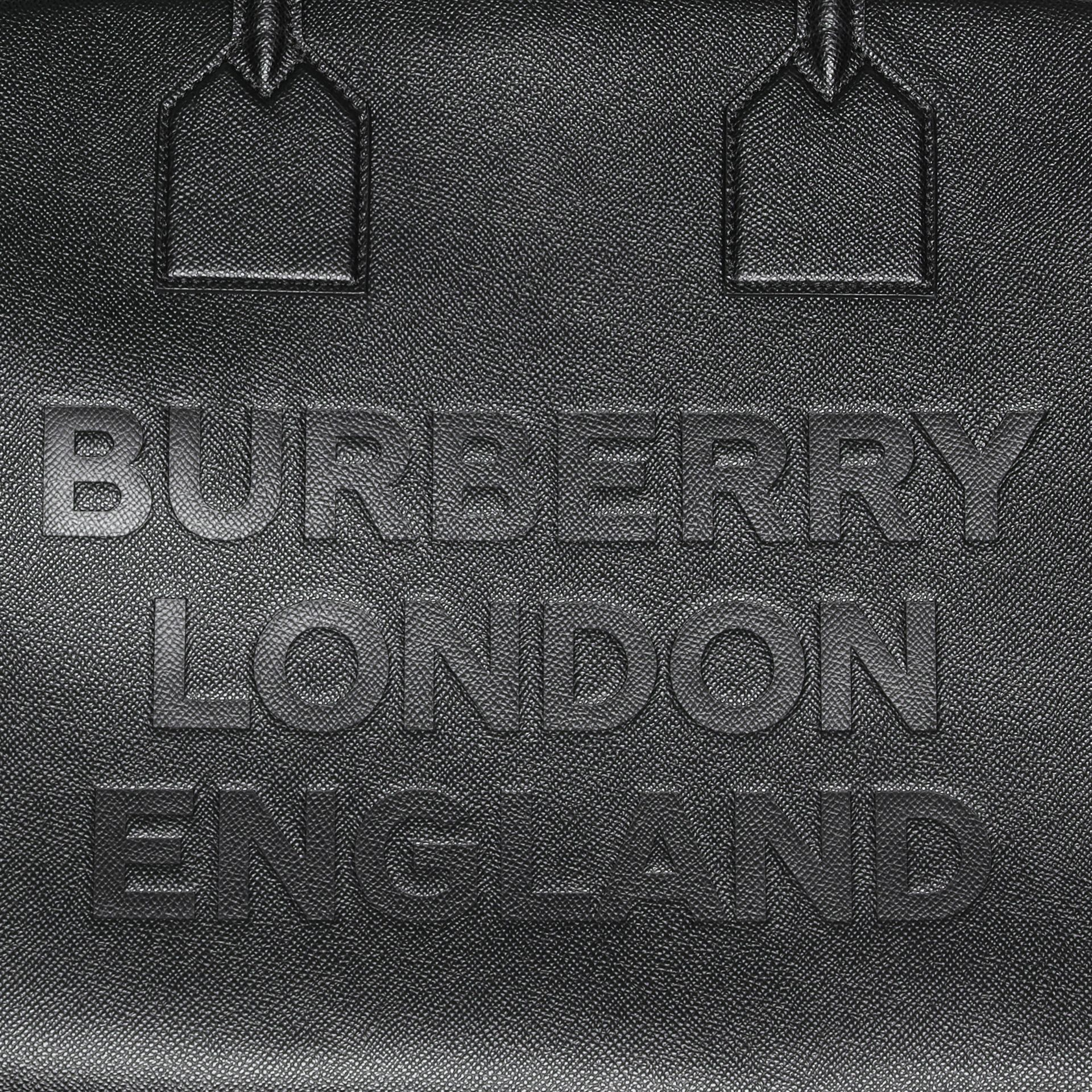 Logo Embossed Leather Holdall in Black | Burberry United Kingdom - gallery image 1