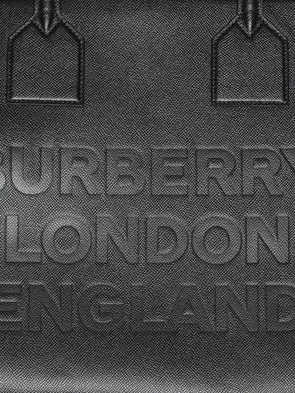 Logo Embossed Leather Holdall in Black | Burberry United Kingdom - cell image 1