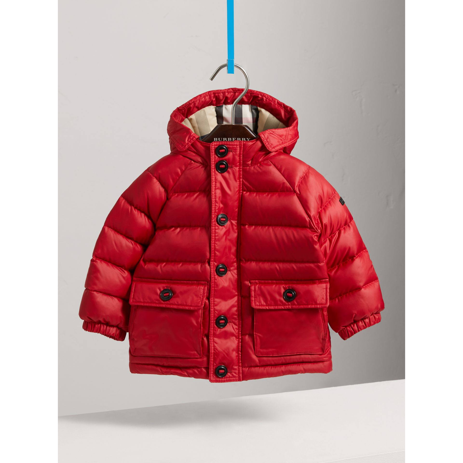Shower-resistant Hooded Puffer Jacket in Parade Red | Burberry Canada - gallery image 0