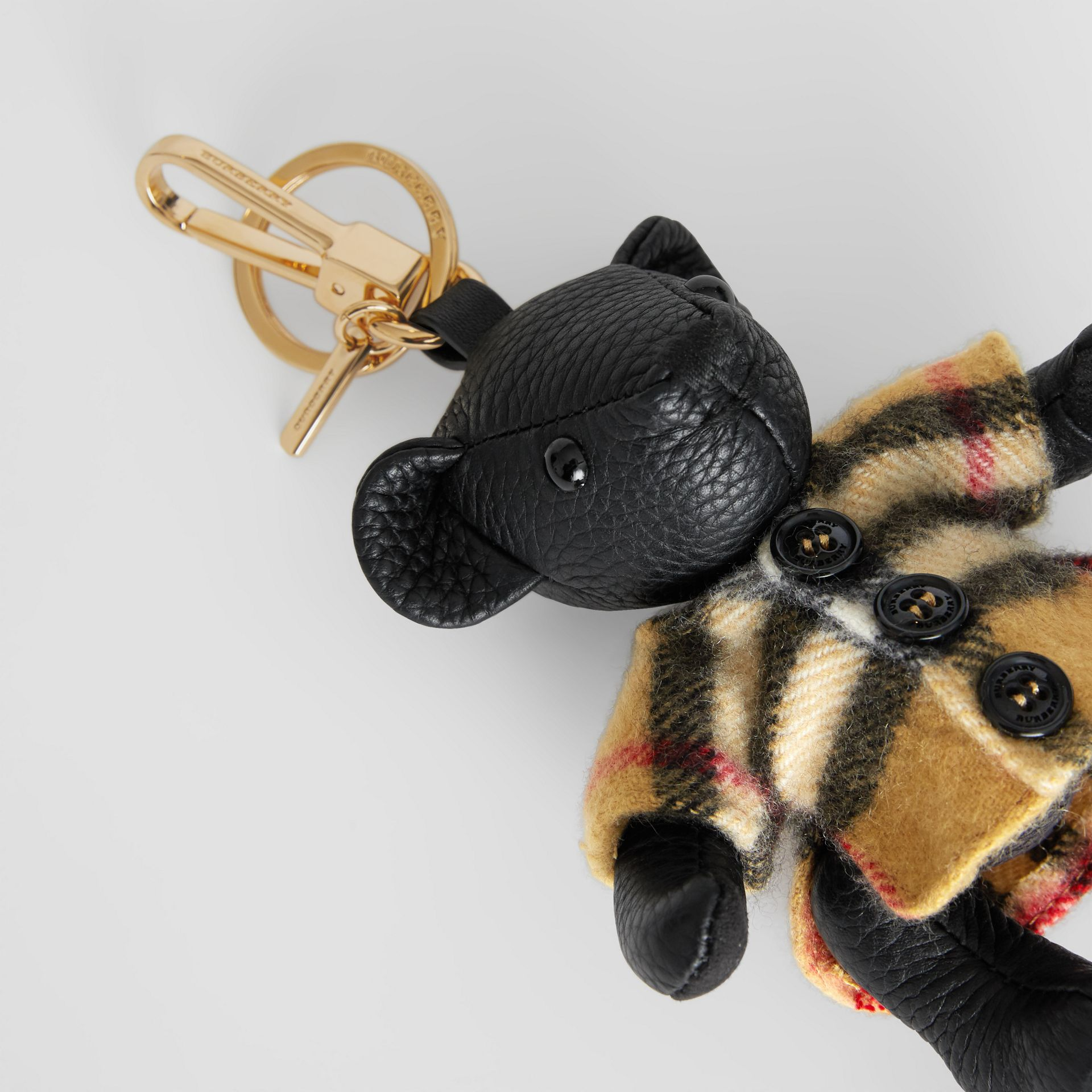 Thomas Bear Charm in Vintage Check Poncho in Black | Burberry United Kingdom - gallery image 1