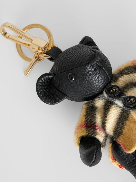 Thomas Bear Charm in Vintage Check Poncho in Black | Burberry - cell image 1