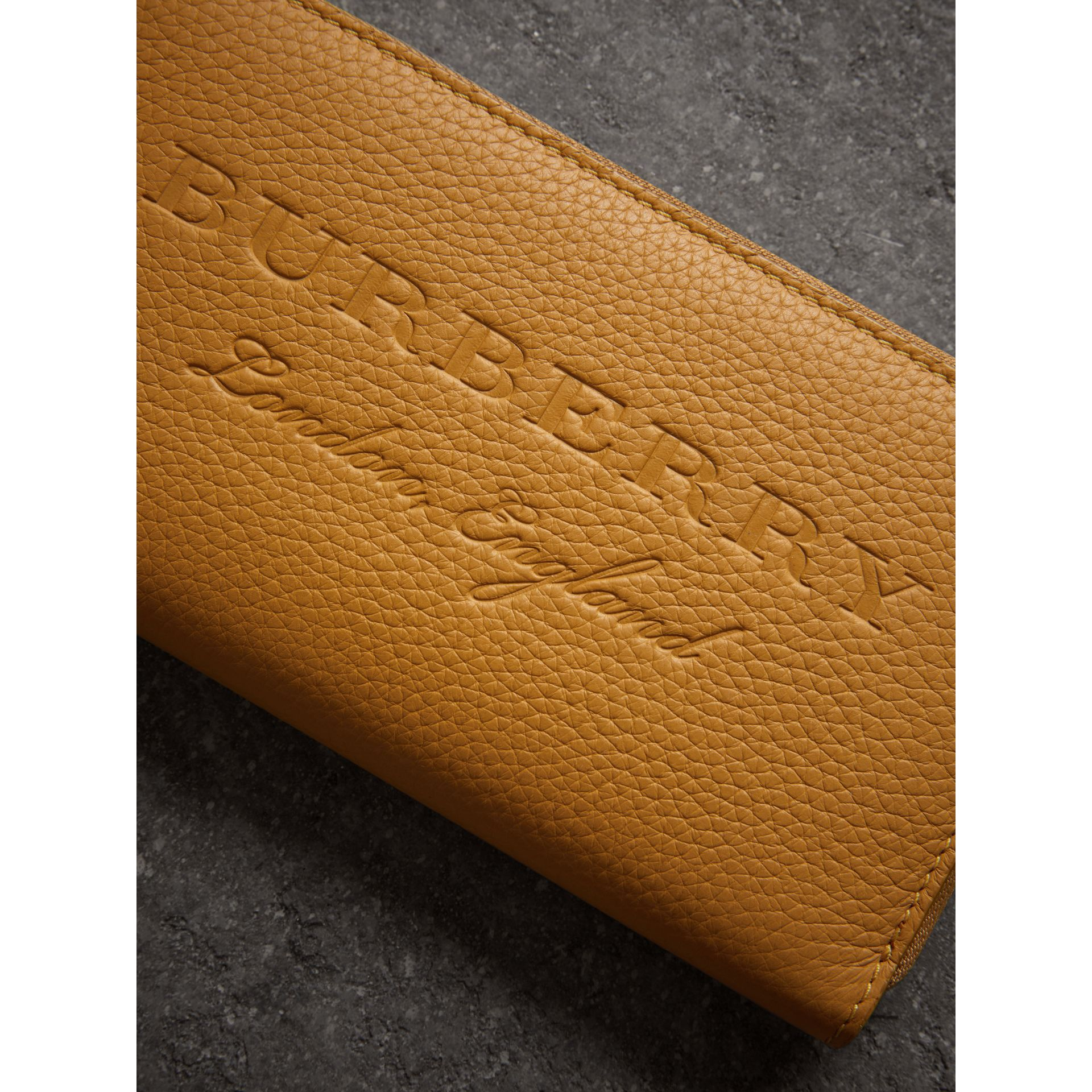 Embossed Leather Ziparound Wallet in Ochre Yellow - Women | Burberry - gallery image 1