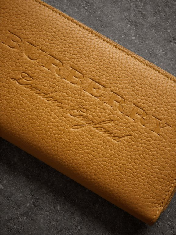 Embossed Leather Ziparound Wallet in Ochre Yellow - Women | Burberry United Kingdom - cell image 1